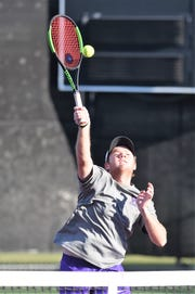 Wylie's Cole Edwards hits a shot at the net during the No. 2 boys doubles match in the Class 5A team tennis state semifinals at he Mitchell Tennis Center at Texas A&M in College Station on Thursday, Nov. 1, 2018. Edwards and Aric Richardson won 7-5, 6-4.