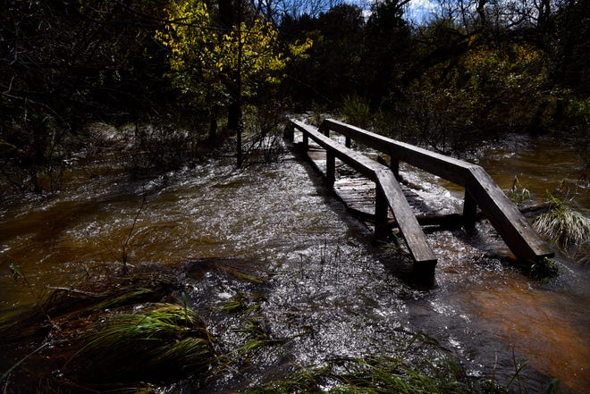 Water flows over a pedestrian bridge at Abilene State Park Thursday. Rain-swollen Elm Creek and overflow from Lake Abilene forced the closure of the park until Thursday, though some crossings like this one are still impassable.