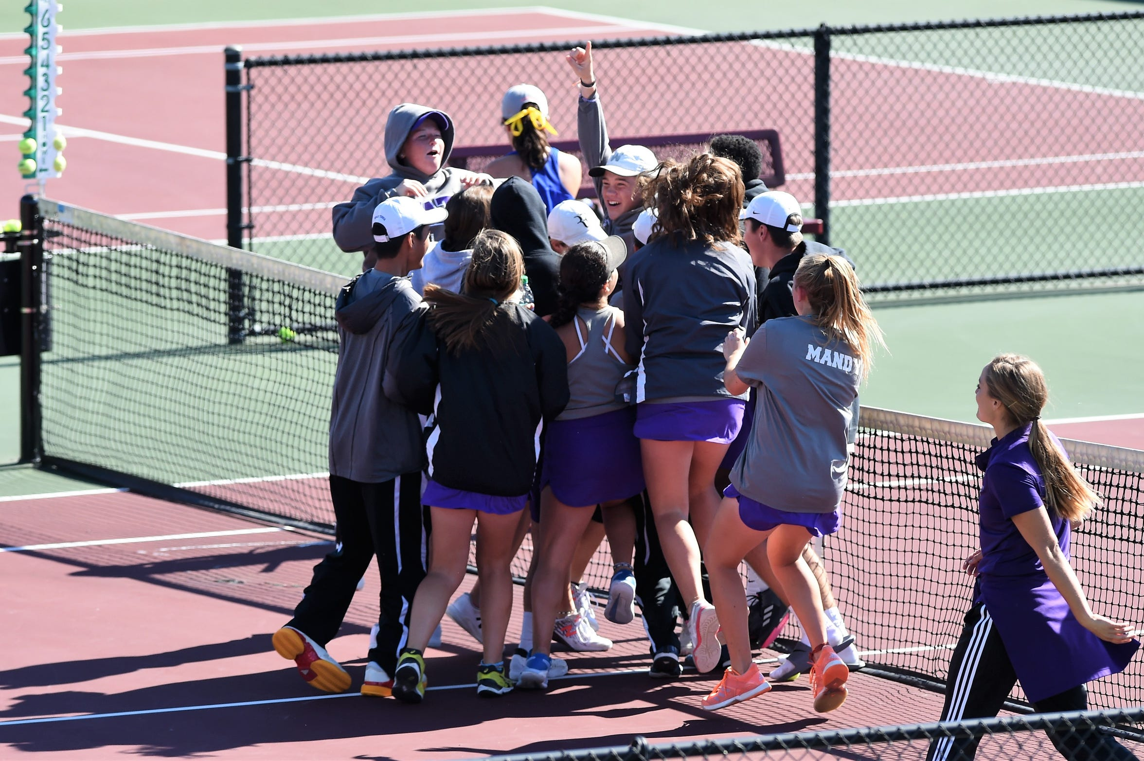 Wylie celebrates winning the 10th match in the Class 5A state semifinal against San Antonio Alamo Heights at the Mitchell Tennis Center in College Station on Thursday, Nov. 1, 2018. The Bulldogs won 12-7 to advance to the state final.