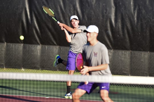 Wylie's Lane Adkins hits a shot behind No. 1 doubles partner Davyn Williford during the Class 5A team tennis state semifinals at he Mitchell Tennis Center at Texas A&M in College Station on Thursday, Nov. 1, 2018. Adkins and Williford won 7-6(4), 6-3.