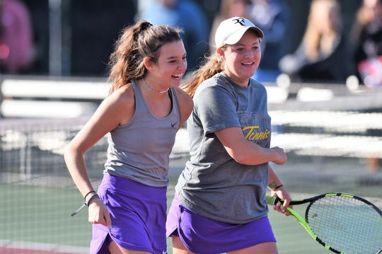 Wylie's Madison Andrews, left, and Hailey Parker smile during the No. 3 girls doubles match in the Class 5A team tennis state semifinals at he Mitchell Tennis Center at Texas A&M in College Station on Thursday, Nov. 1, 2018. Andrews and Parker came back to win 3-6, 7-6(3), 10-6.