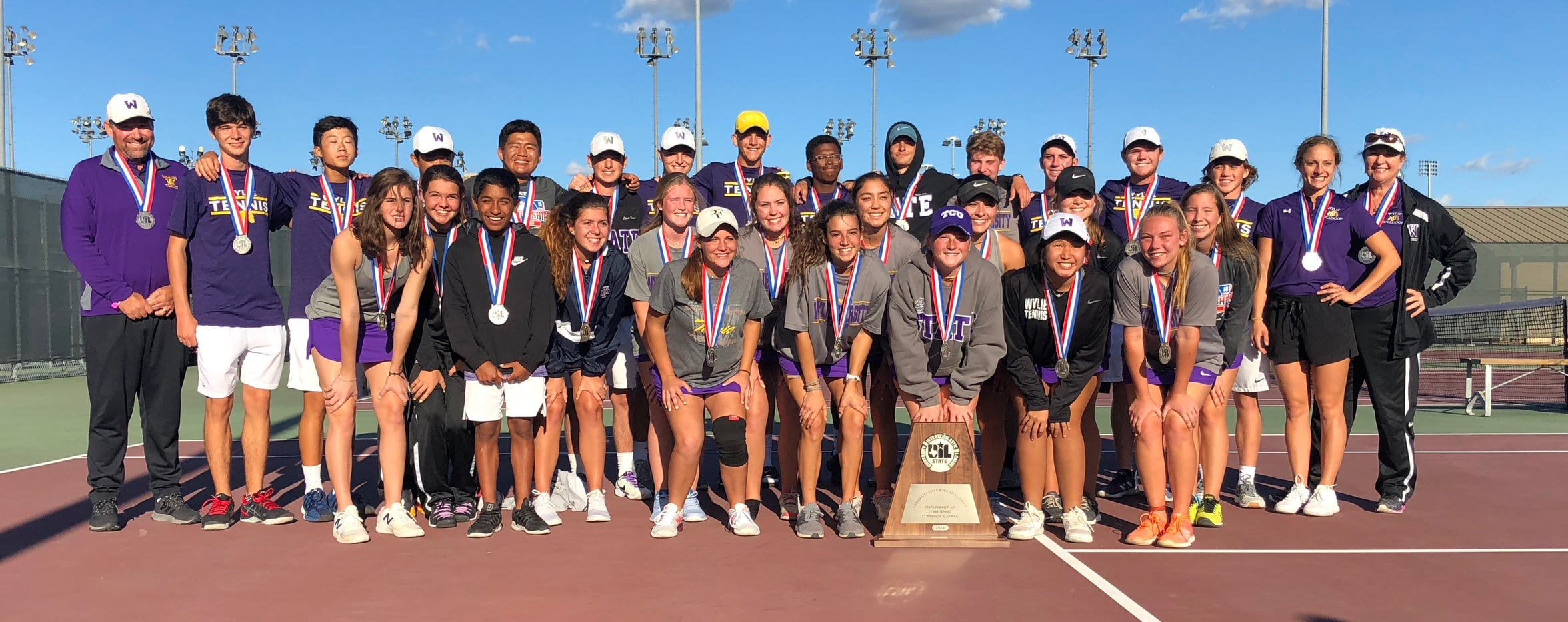 The Wylie tennis team poses with the Class 5A state runner-up trophy after falling to Highland Park in the final on Thursday in College Station.