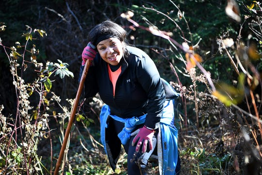 Tanya Cummings takes a second to rest as she hikes the unofficial Plott Balsam Trail with Pathways to Parks on Oct. 30, 2018. Pathways to Parks is an outdoors group that aims to get more people of color outside and into our National Parks.