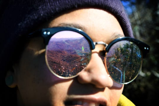A mountain view is reflected in Elsea Brown's sunglasses as she hikes Waterrock Knob with Pathways to Parks on Oct. 30, 2018.
