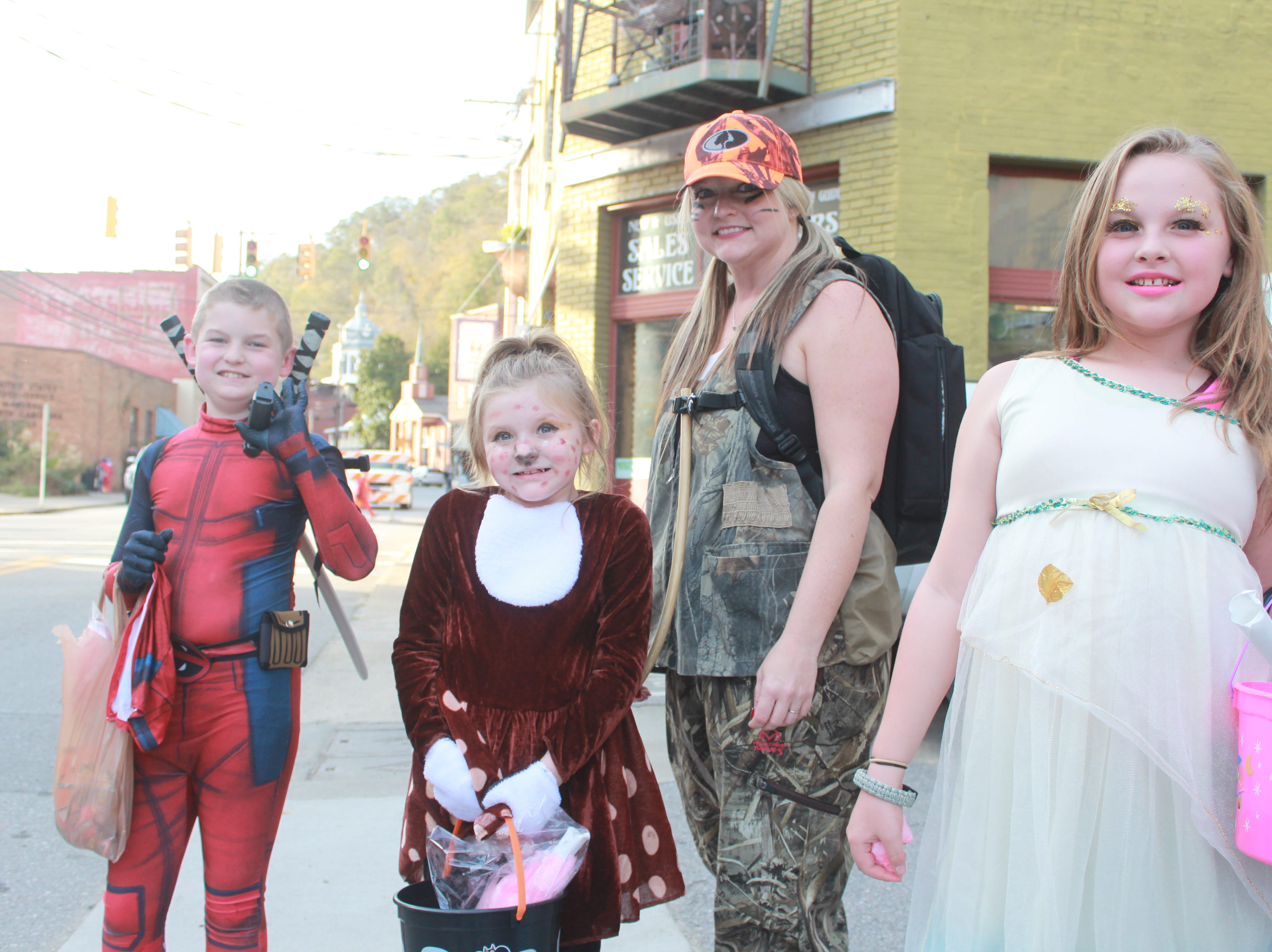 Ransom Ledford as Deadpool joined Aaliyah, Shelley and Gabby Phillips for some trick-or-treating in downtown Marshall.