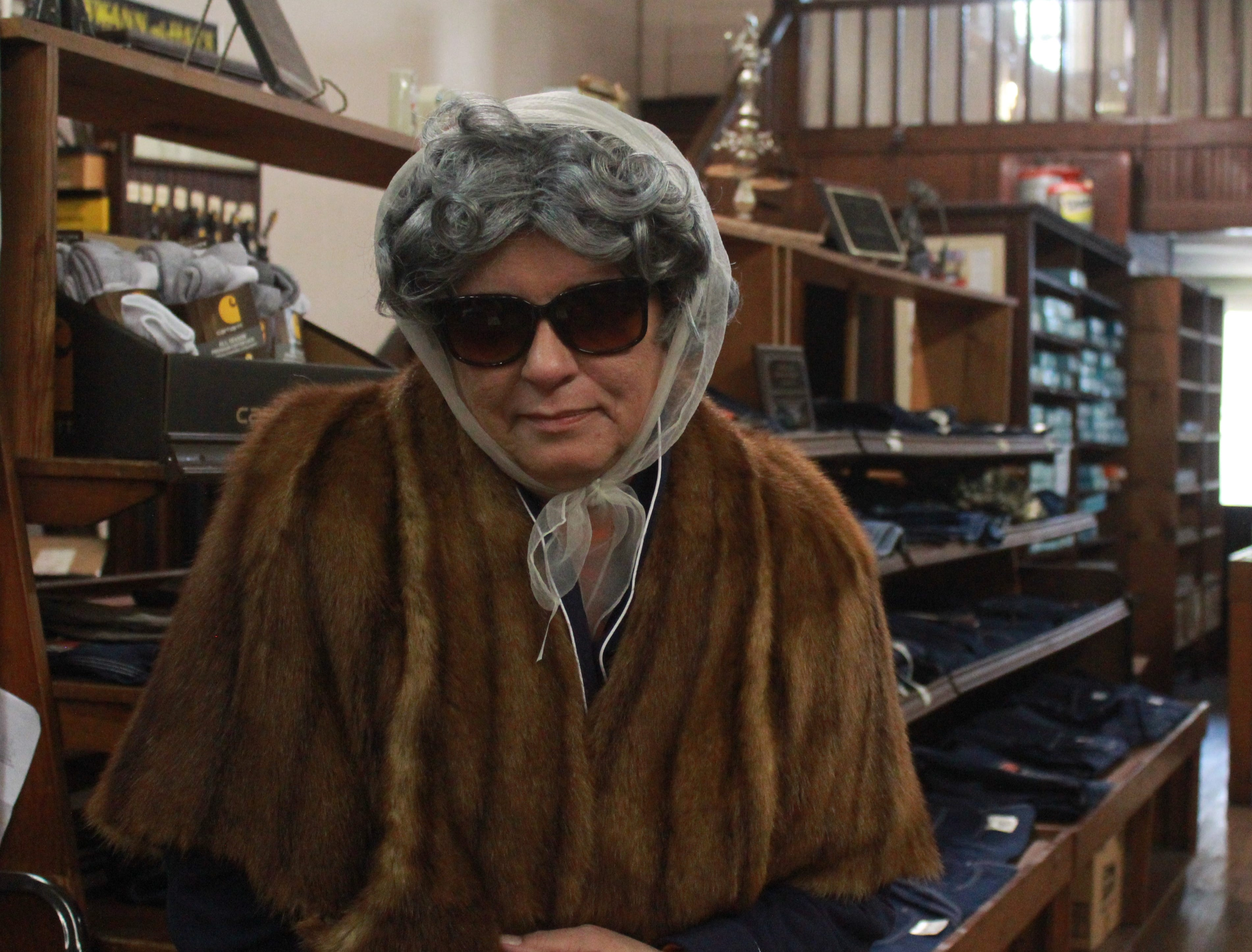 Georgette Shelton of Marshall department store Penland & Sons disguises herself as an old woman.