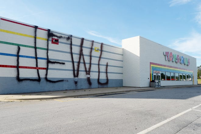 The Toys R Us on Brevard Road had been painted in graffiti on Oct. 3, 2018.