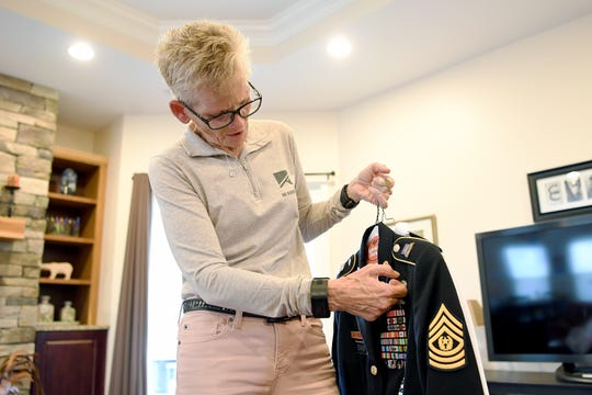 Retired Command Sgt. Maj. Gretchen Evans explains the patches, pins and awards that decorate her uniform and were earned during her 27 years of service before she was deafened by a mortar blast in Afghanistan. Evans will be featured in a television show airing on CBS on Sunday, Nov. 4, 2018.