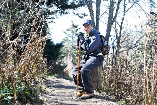Larry Pender takes a seat as he waits for the rest of the group to catch up to him on the trail while hiking down Waterrock Knob with Pathways to Parks on Oct. 30, 2018. Pathways to Parks is an outdoors group that aims to get more people of color outside and into our National Parks.