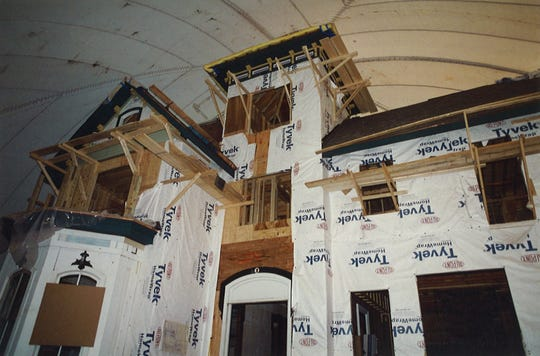 A view from inside a construction bubble shows work to rebuild the home's second and third floors.