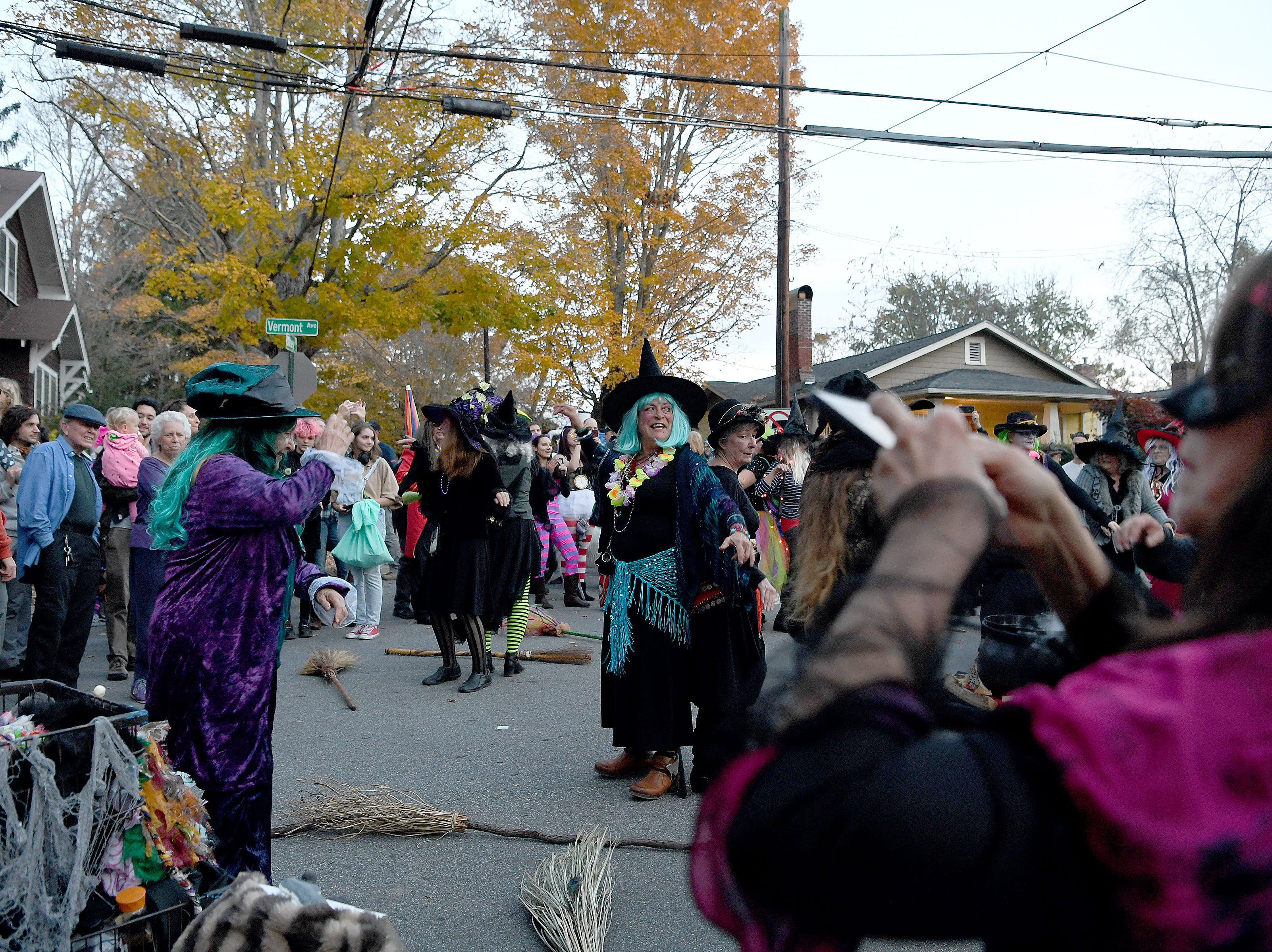 Witches flash mob an intersection of Vermont Avenue with a choreographed dance during the street's annual Halloween celebration on Oct. 31, 2018.