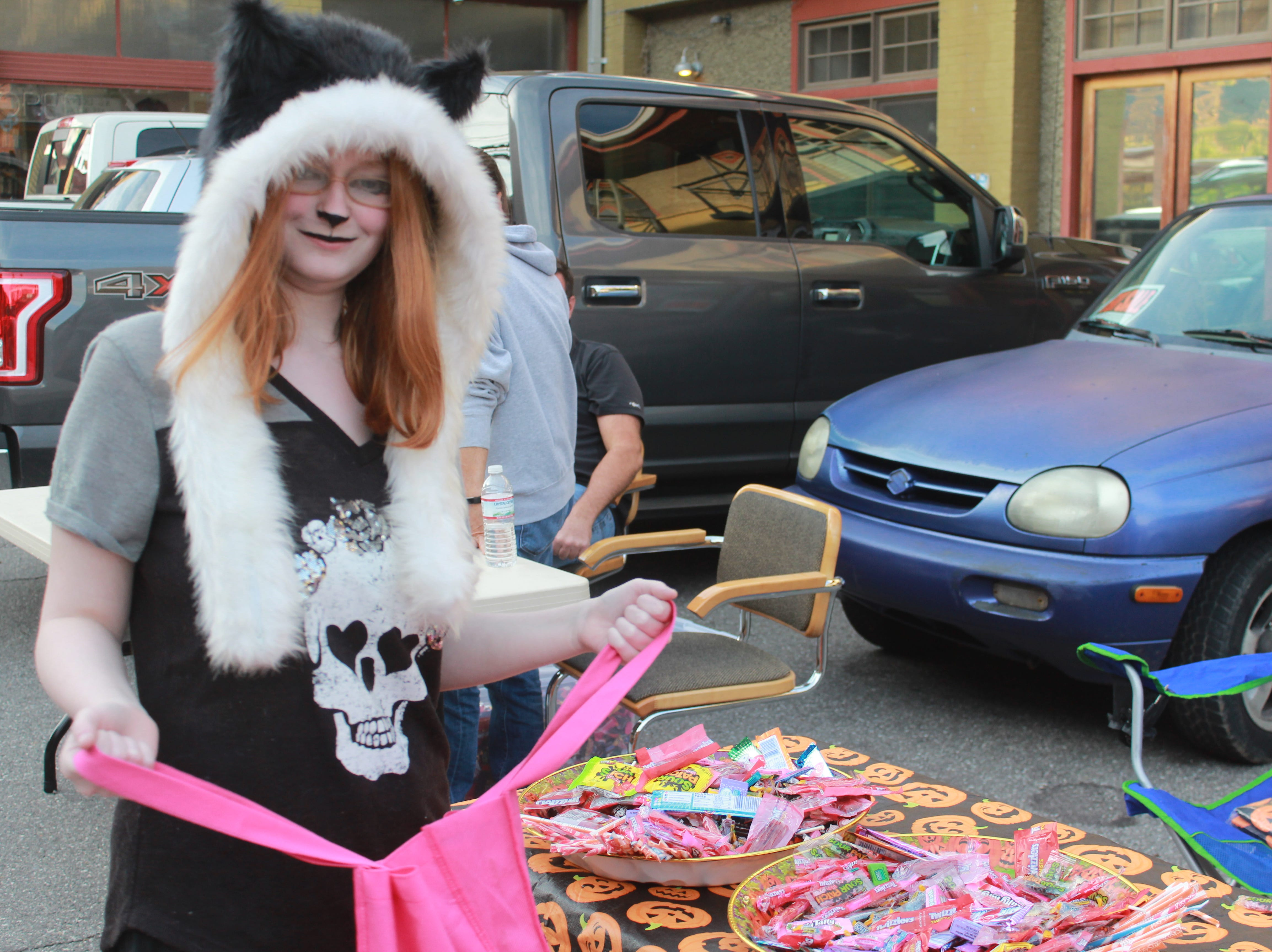Kylie Norton grabs some candy in her cat costume.