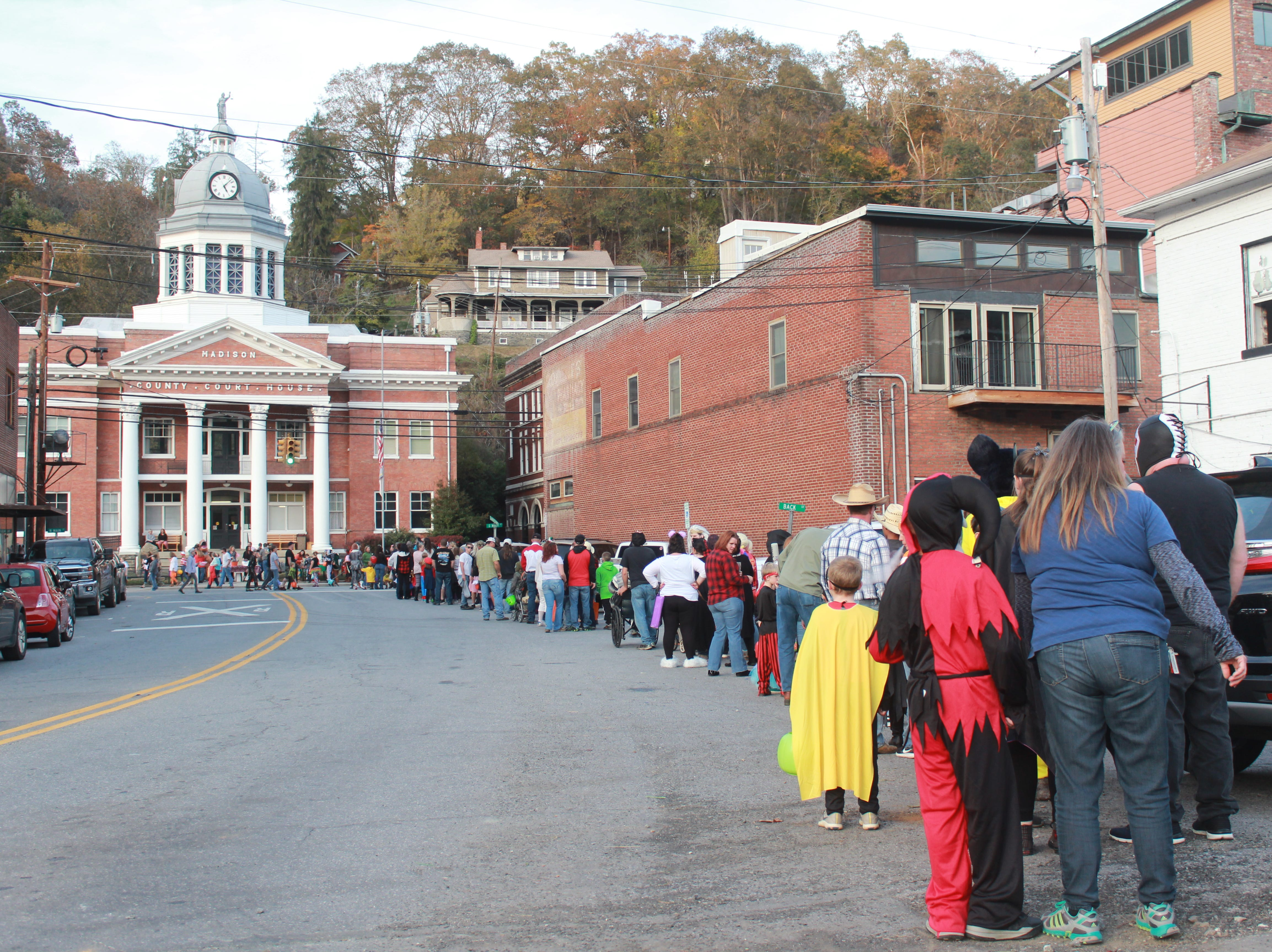 The line of trick-or-treaters snaked from Main Street to the railroad tracks during the height of Halloween madness in downtown Marshall.