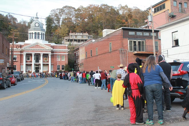 The line of trick-or-treaters snaked from Main Street to the railroad tracks during the height of the 2018 Halloween festivities in downtown Marshall.