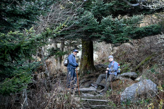 """Larry Pender, left, and Jerome """"Forest"""" Glassman wait for the rest of the group to catch up to them on the trail as they hike Waterrock Knob with Pathways to Parks on Oct. 30, 2018. Pathways to Parks is an outdoors group that aims to get more people of color outside and into our National Parks."""