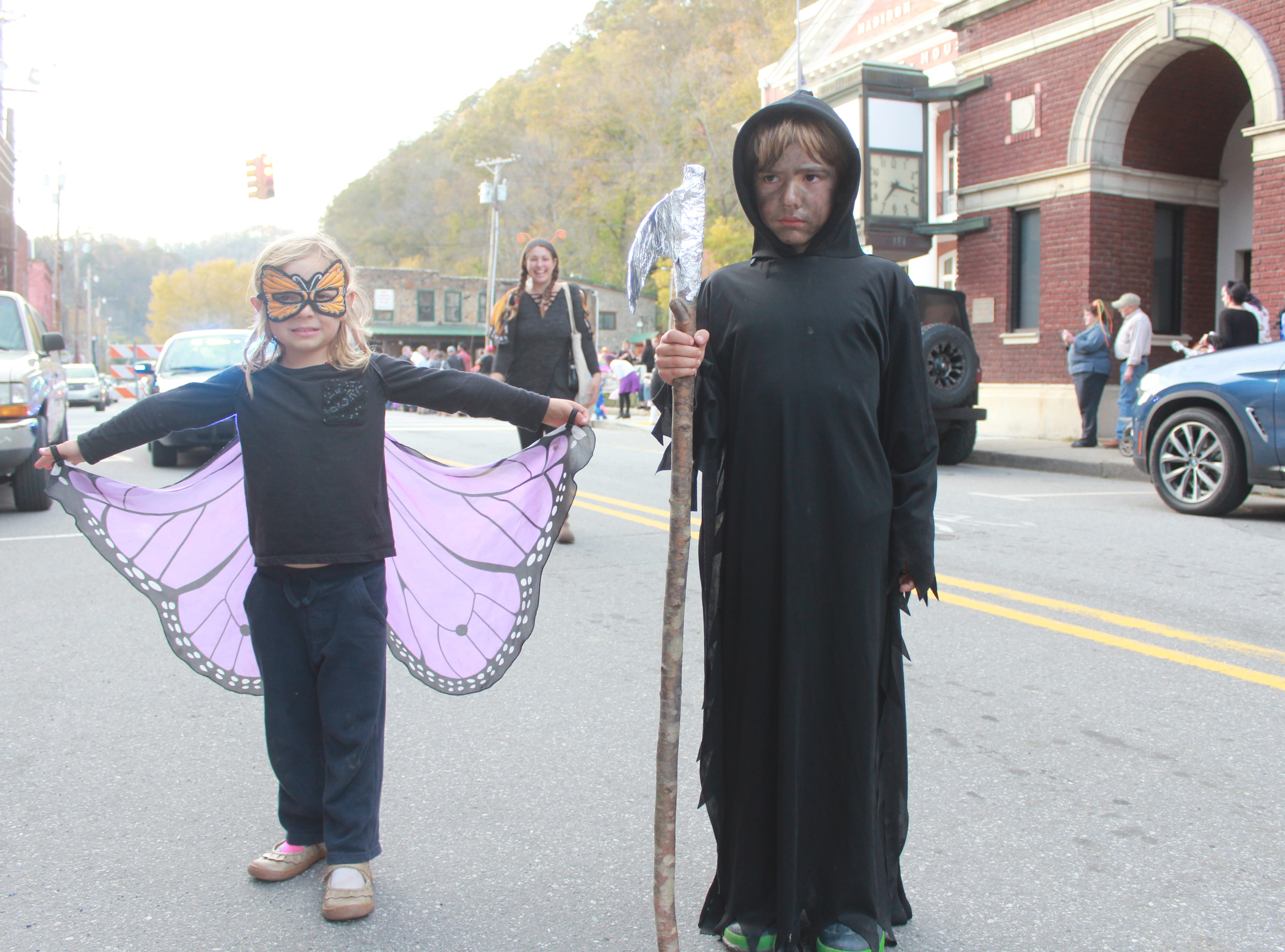 Ember and Talan Watson stop traffic as a butterfly and the grim reaper.