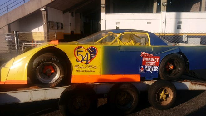 The Michael Miller Memorial Foundation unveiled the race car after Battle Creek Central High School's football practice on Wednesday