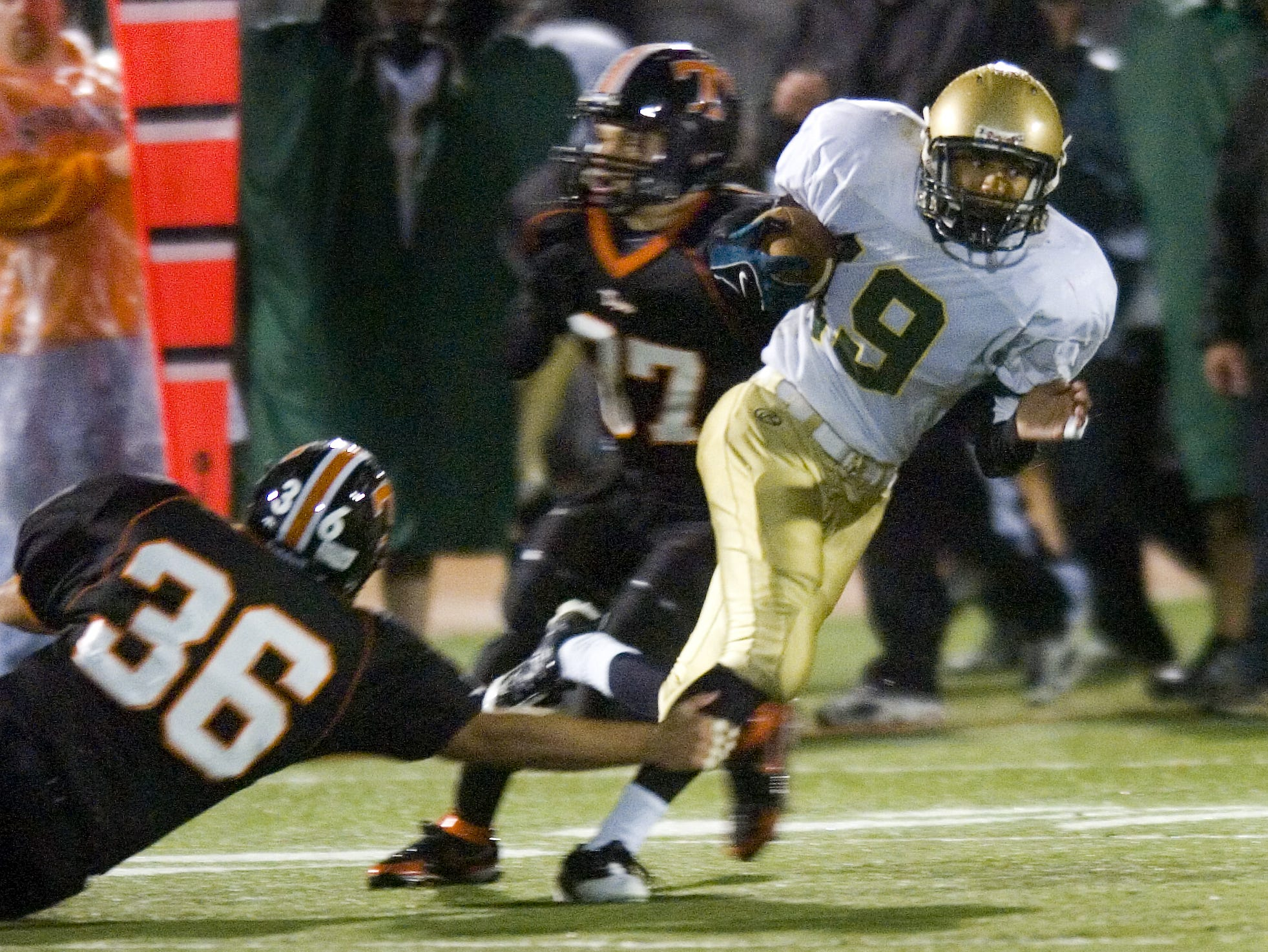 Union-Endicott's Chris Nichols tries for the grab as Vestal's Kameron Sowell carries the ball in the 1st half of a 2008 game at Union-Endicott Saturday.