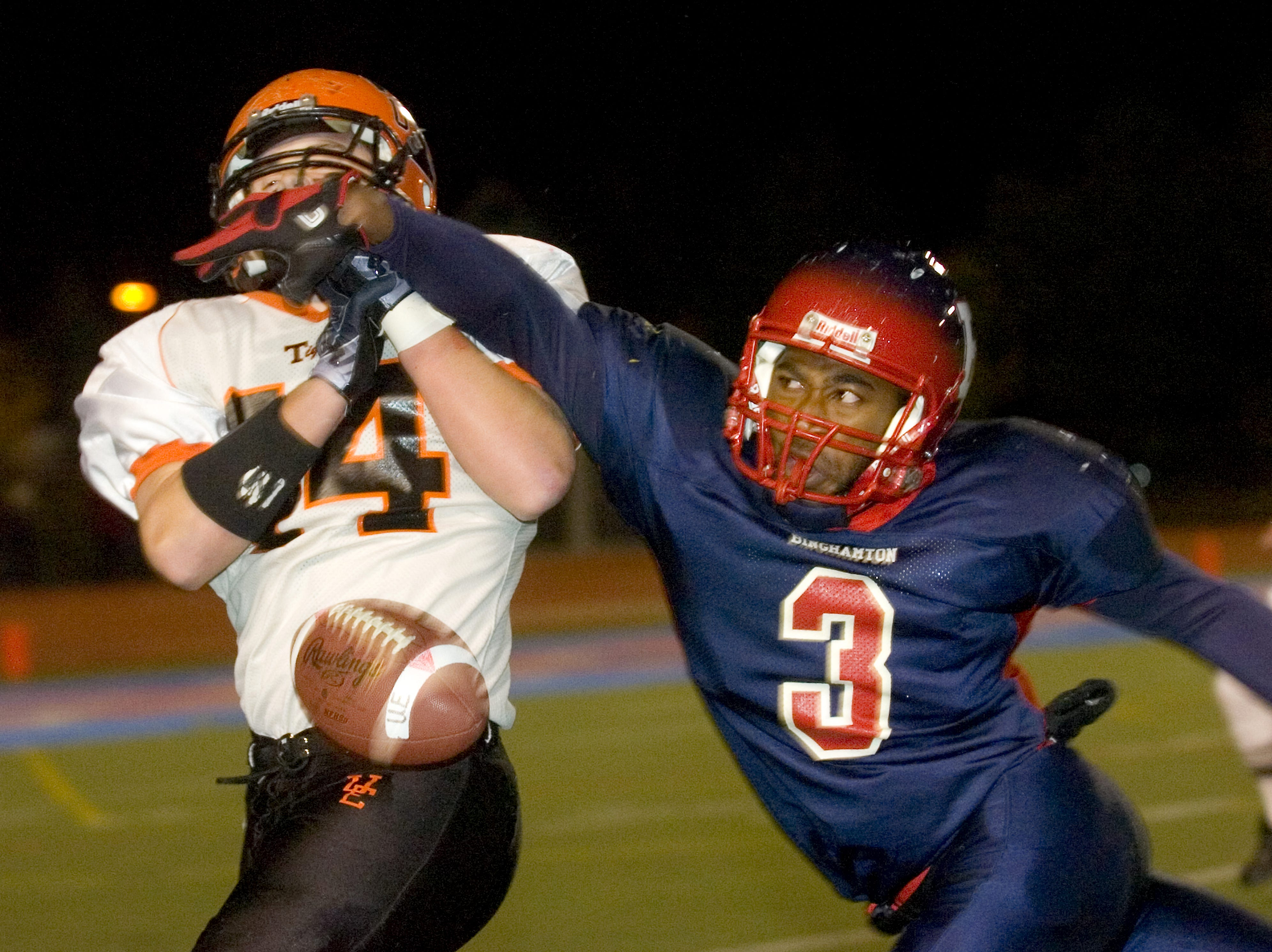Binghamton's Delroy Young, right, breaks up a pass to Union-Endicott's Troy Beddoe in the first quarter of the Section 4 Class AA football semifinal game in 2010 at Alumni Stadium in Binghamton.