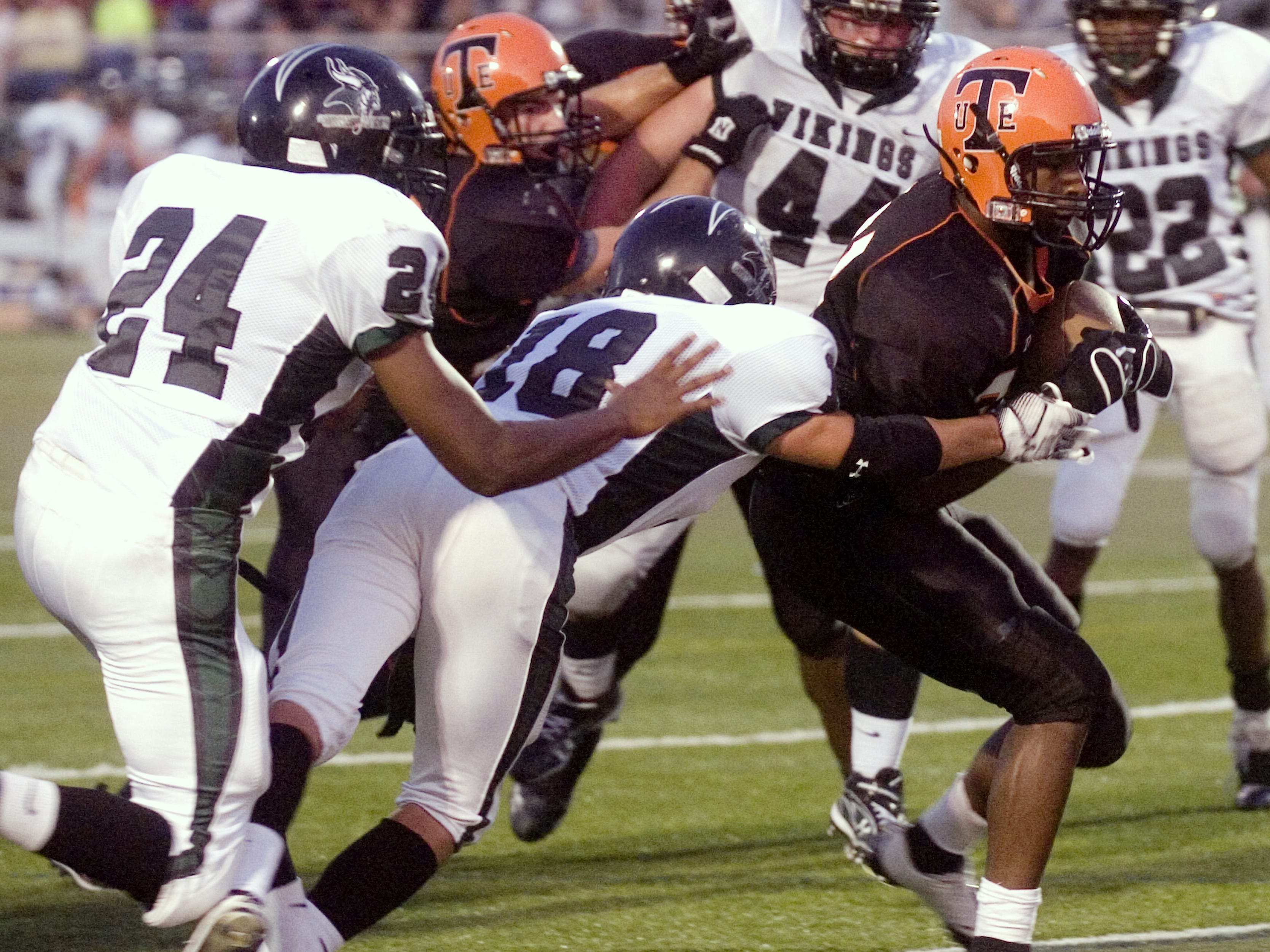 Union-Endicott's Jordan Thomas, right, runs into the end zone past Corning West defenders Devin King, left, and Alex Perry in the second quarter in 2009 at Ty Cobb Stadium.