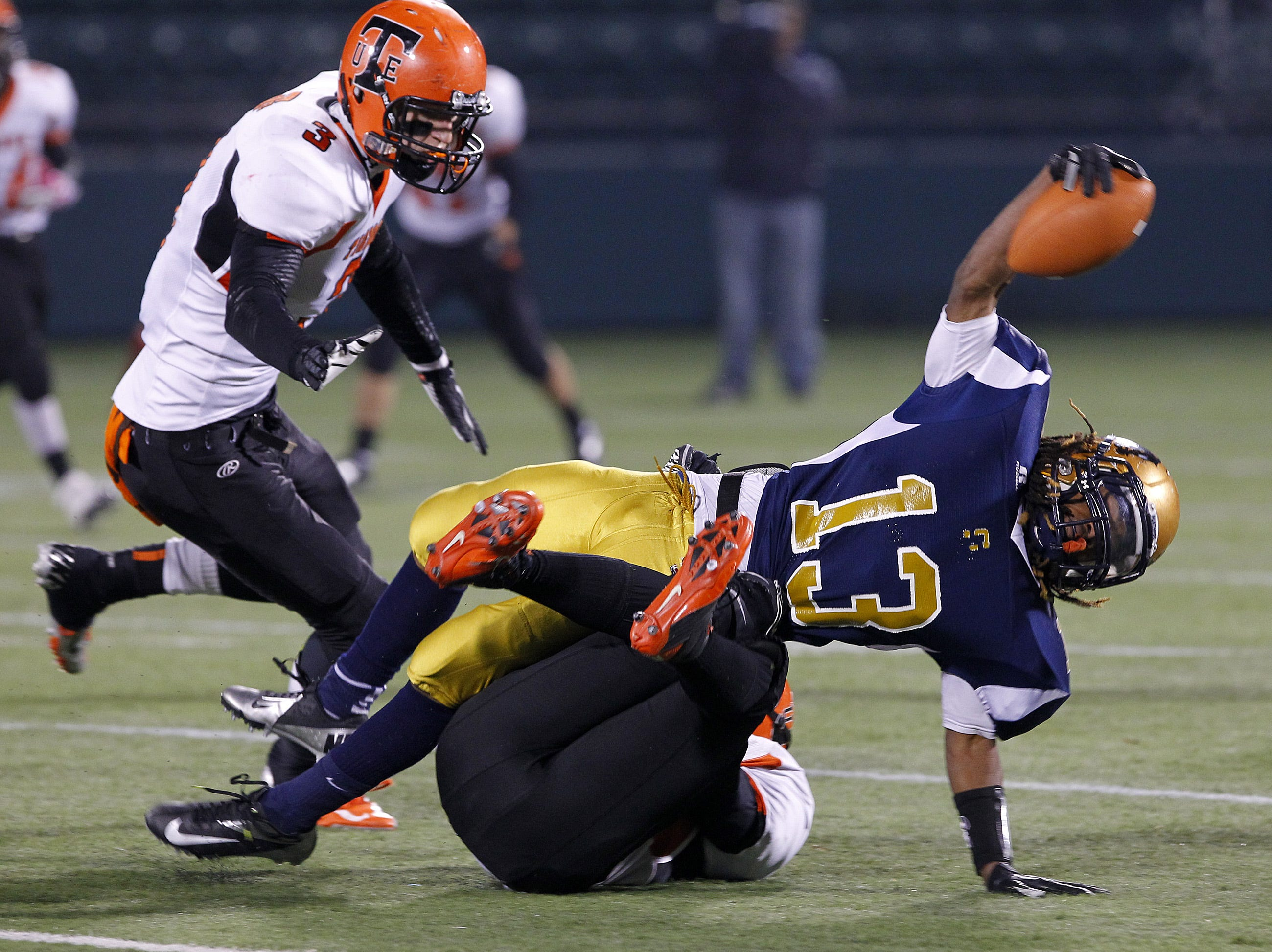 Sweet Home's Kahlil Humphrey, right, runs over Union-Endicott's Michael Cooper for yardage before teammate Caleb Scepaniak can lend support during NYS Class A semifinal playoff football action football action at Sahlen's Stadium in Rochester Friday evening, November 16, 2012.