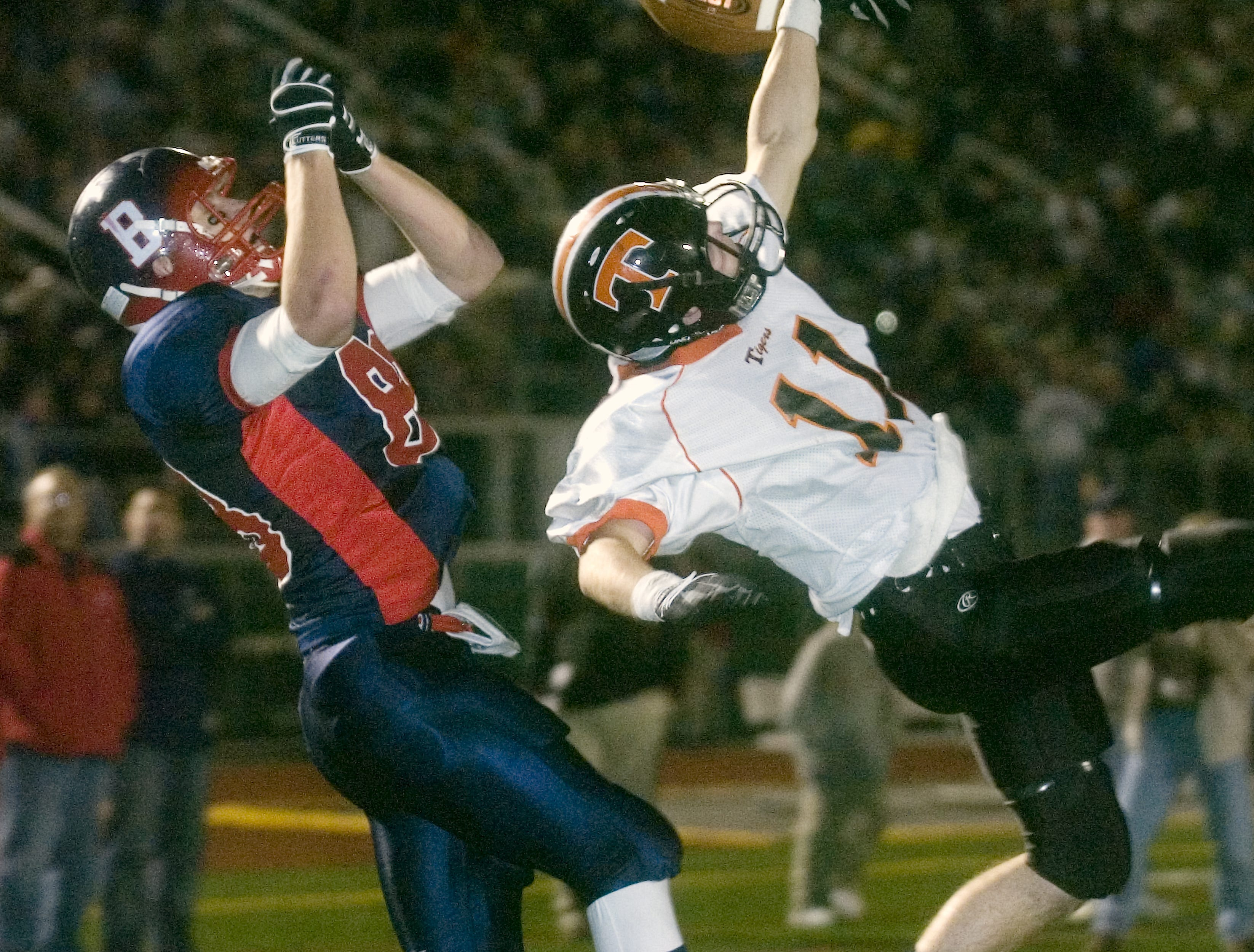 Union-Endicott's Josh Rose, right, swats away the ball intended for Binghamton's Nate Papso in the second quarter of a 2008 game at Dick Hoover Stadium.