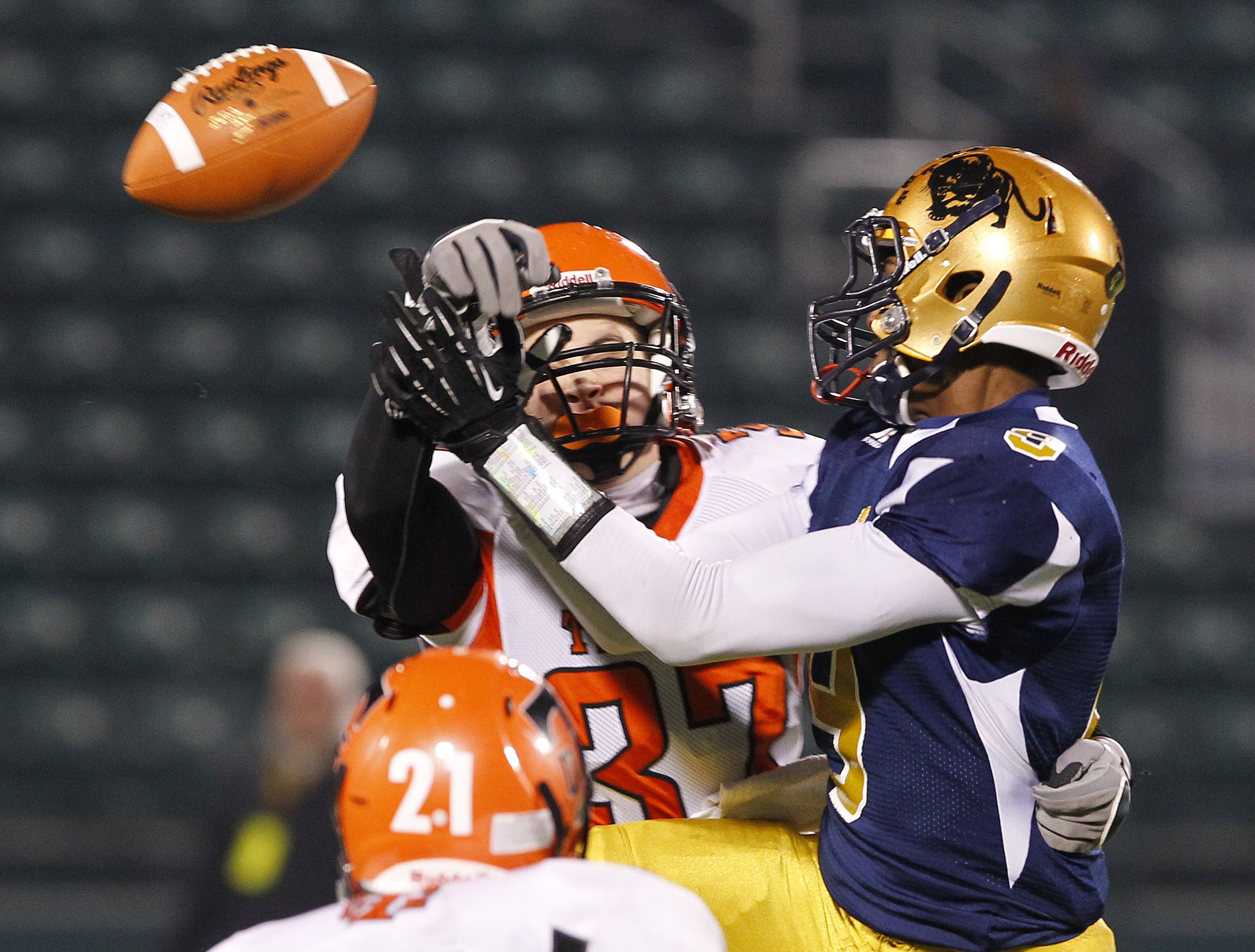 Union-Endicott's Matt DePalmo, left, knocks a pass away from Sweet Home's Calvin Martin during NYS Class A semifinal playoff football action football action at Sahlen's Stadium in Rochester Friday evening, November 16, 2012.