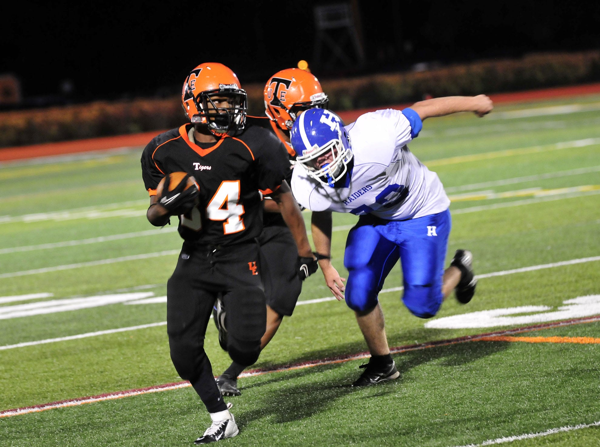 Union-Endicott's Hezekiah Morgan is chased by Horseheads' Mitchell Elliott on a punt return in 2012.
