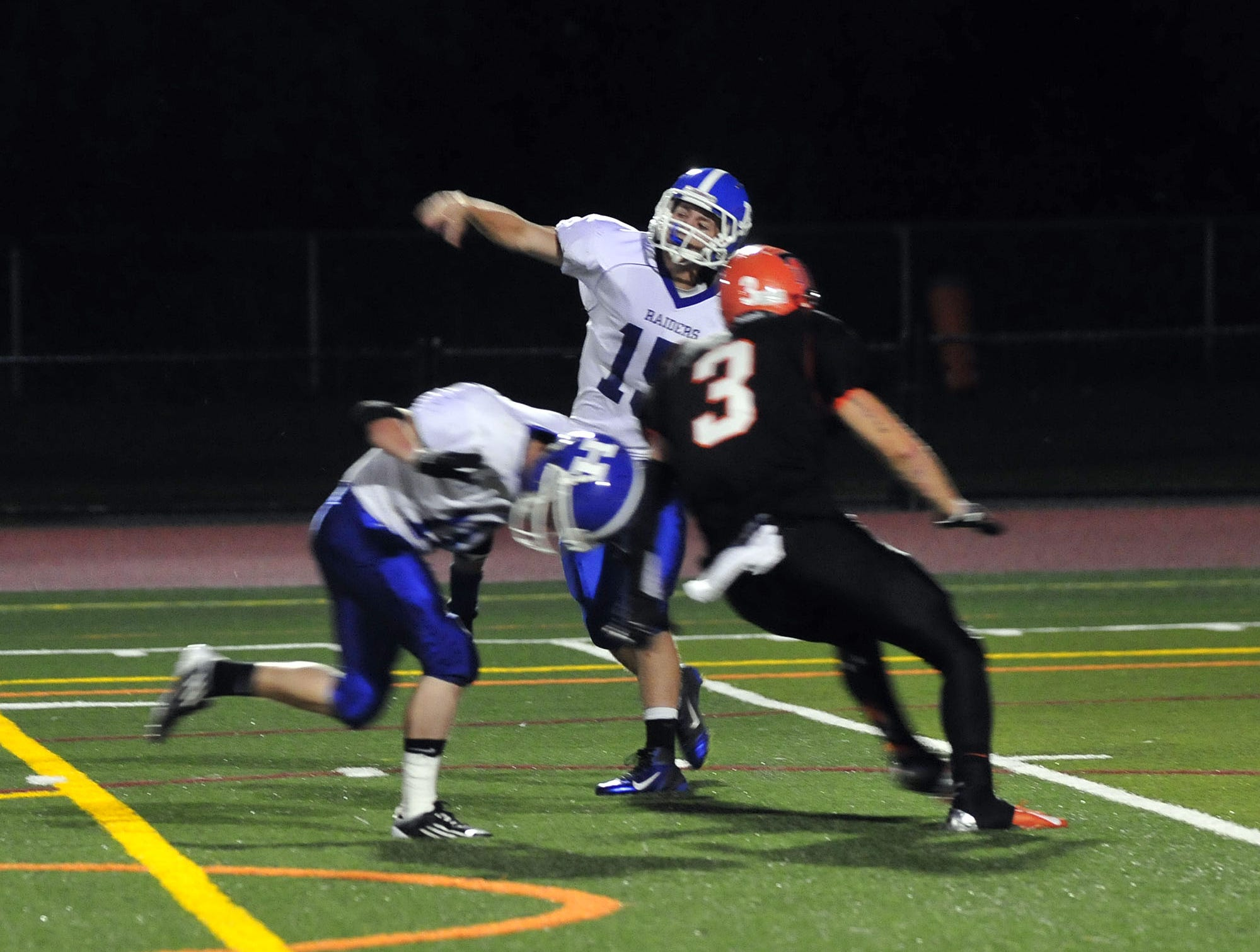 Horseheads quarterback Trevor Dickson attempts a pass before getting tackled by Union-Endicott's Caleb Scepaniak in 2012.