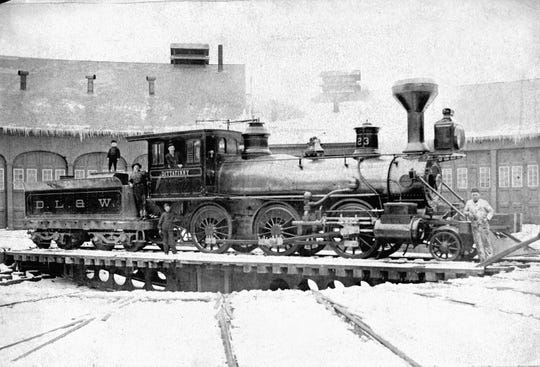A Matt Shea locomotive stops on the Erie tracks in Binghamton in 1914.