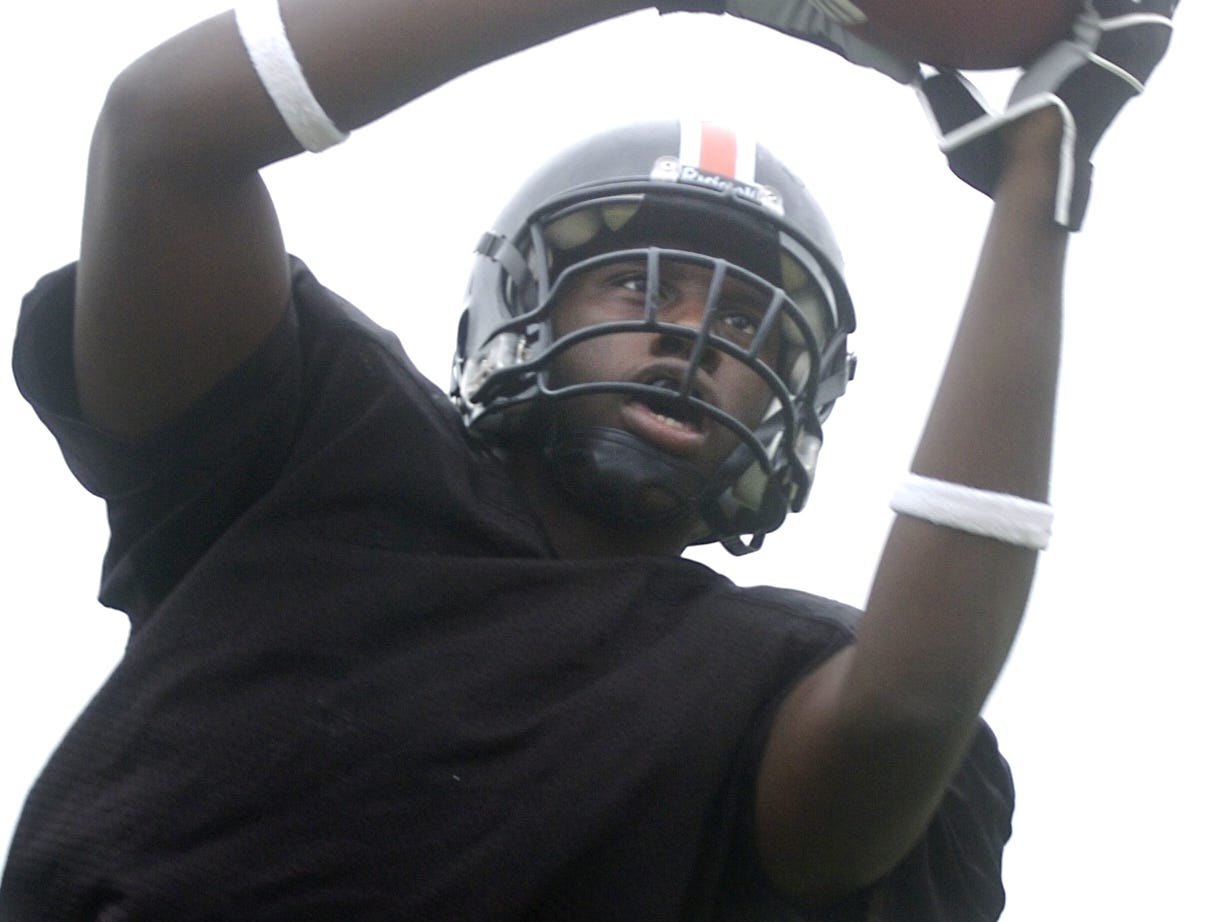 In a 2005 photo, Chandler Jones shows off his hands as a tight end at Union-Endicott.