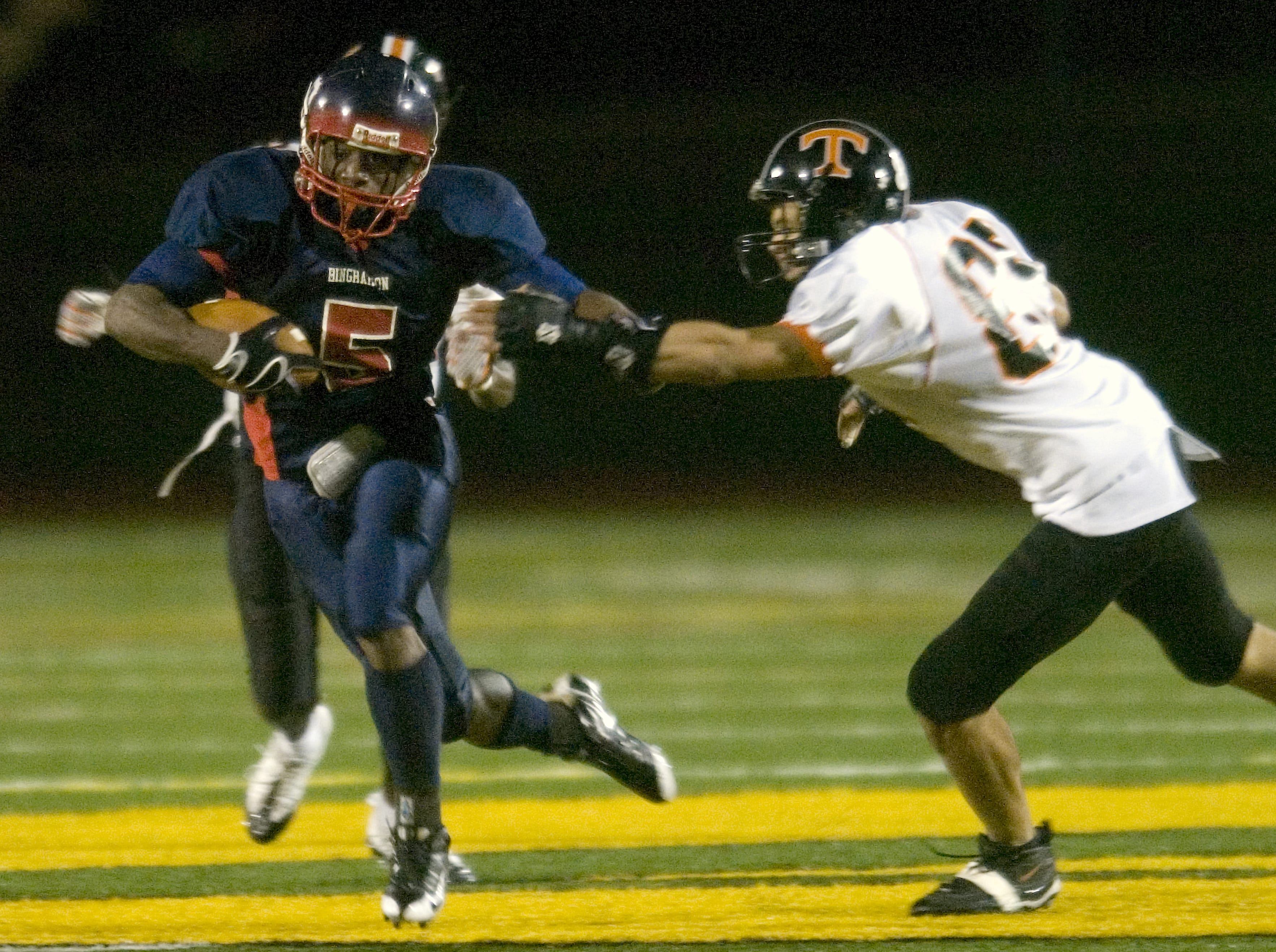 Binghamton's Jamar Smith, left, gets away from Union-Endicott's Matt Stanley in the second quarter of a 2008 game at Dick Hoover Stadium.