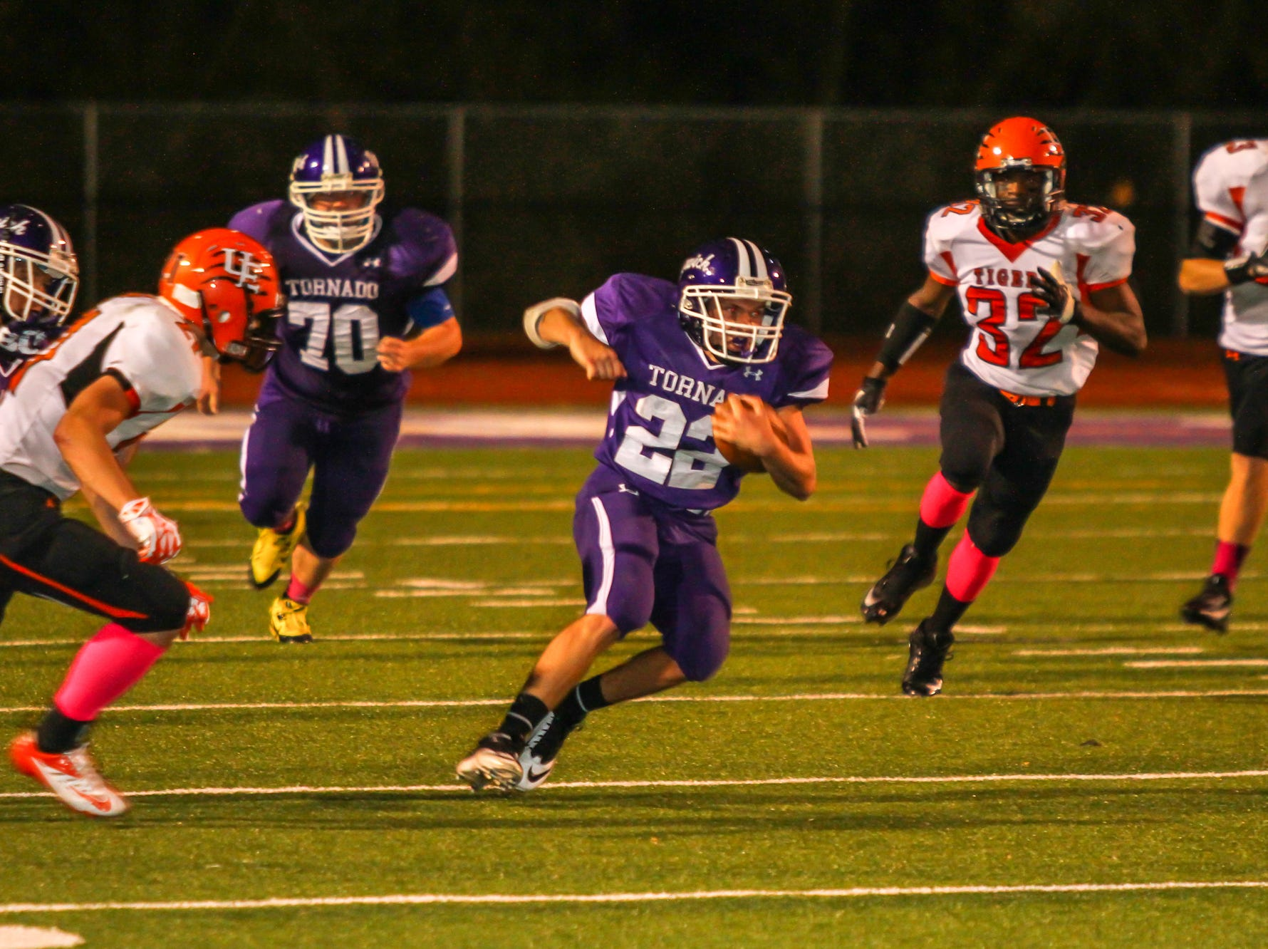 In 2013, Norwich's Keegan Franklin looks for running room against the Union-Endicott defense. Franklin was limited to 14 yards rushing on 10 carries by the Tigers.