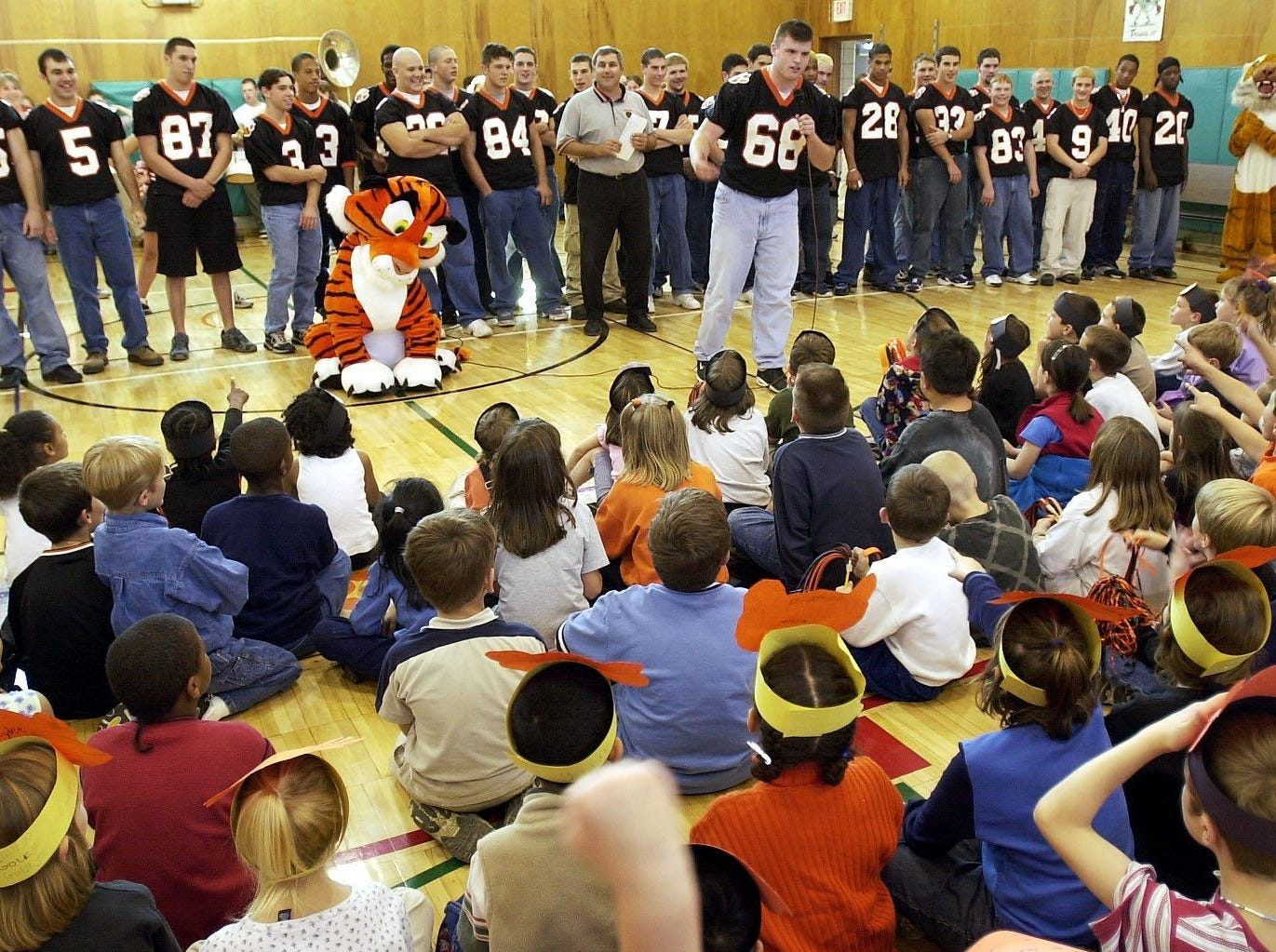 In 1999, Union-Endicott High School football Team Captain Dave Archer speaks to students during a pep rally held Friday at the Charles F. Johnson School. The rally before the traditional U-E/Vestal game has been held at the elementary school for 25 years.