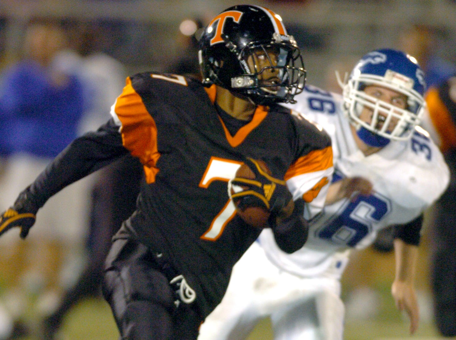 Union-Endicott's Jermaine Thomas runs with the ball after a successful interception as Horseheads' Brian Grose gives chase in the third quarter of a 2005 game at UE.
