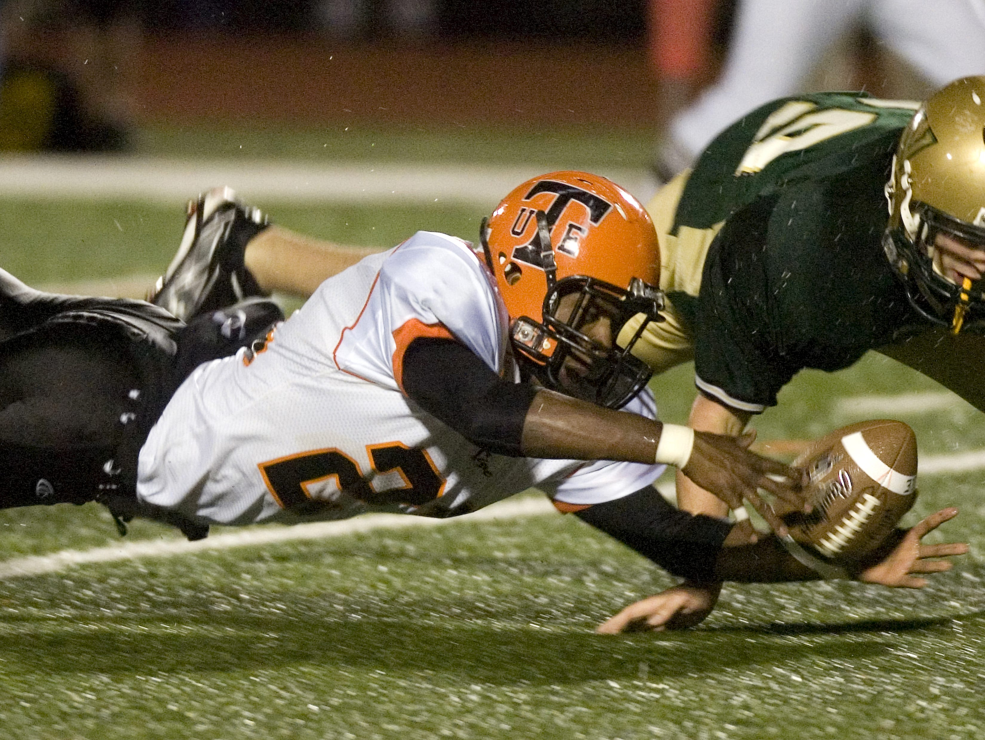 Union-Endicott's Jordan Thomas, left, recovers his own fumble before Vestal's Brock Leonard could get to the ball in the second quarter of a 2009 game at Dick Hoover Stadium.