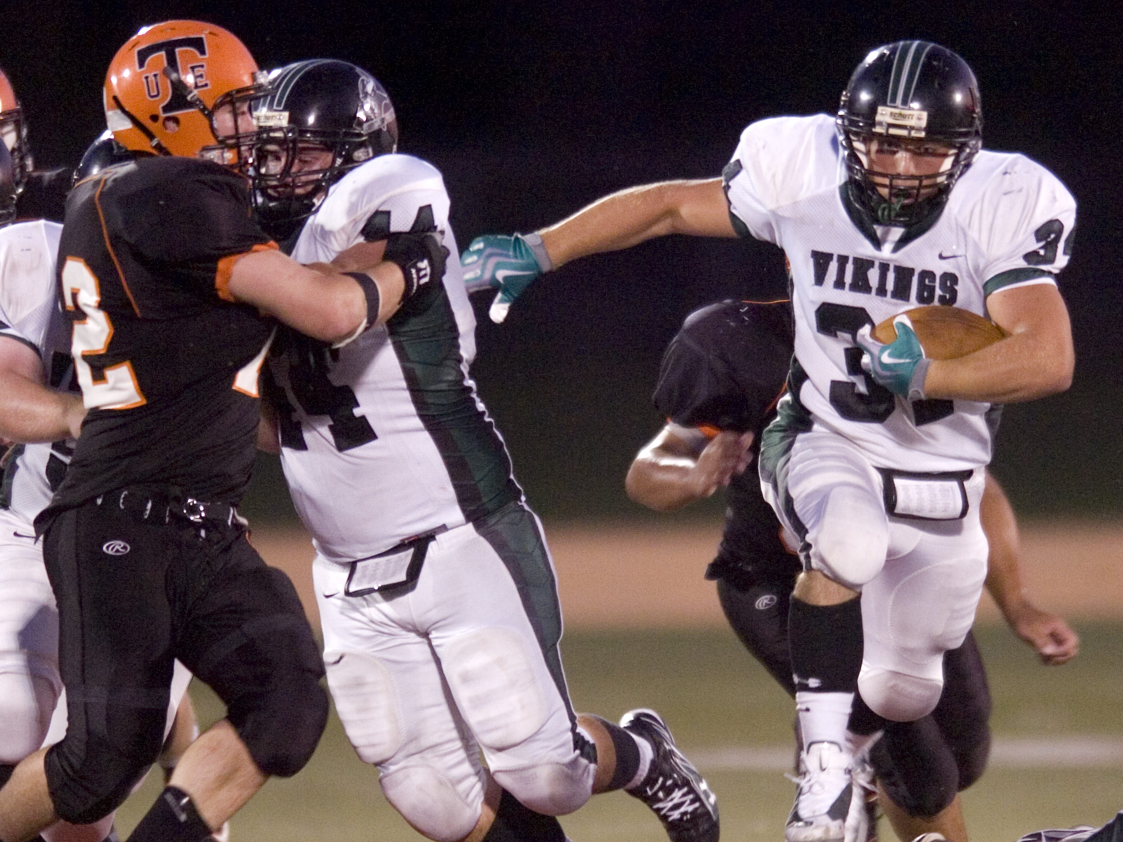 Corning West's Anthony Nybeck, right, gets a block from Kevin Childs, holding back Union-Endicott's Mike Bishop at left, in the second quarter of a 2009 game at Ty Cobb Stadium.
