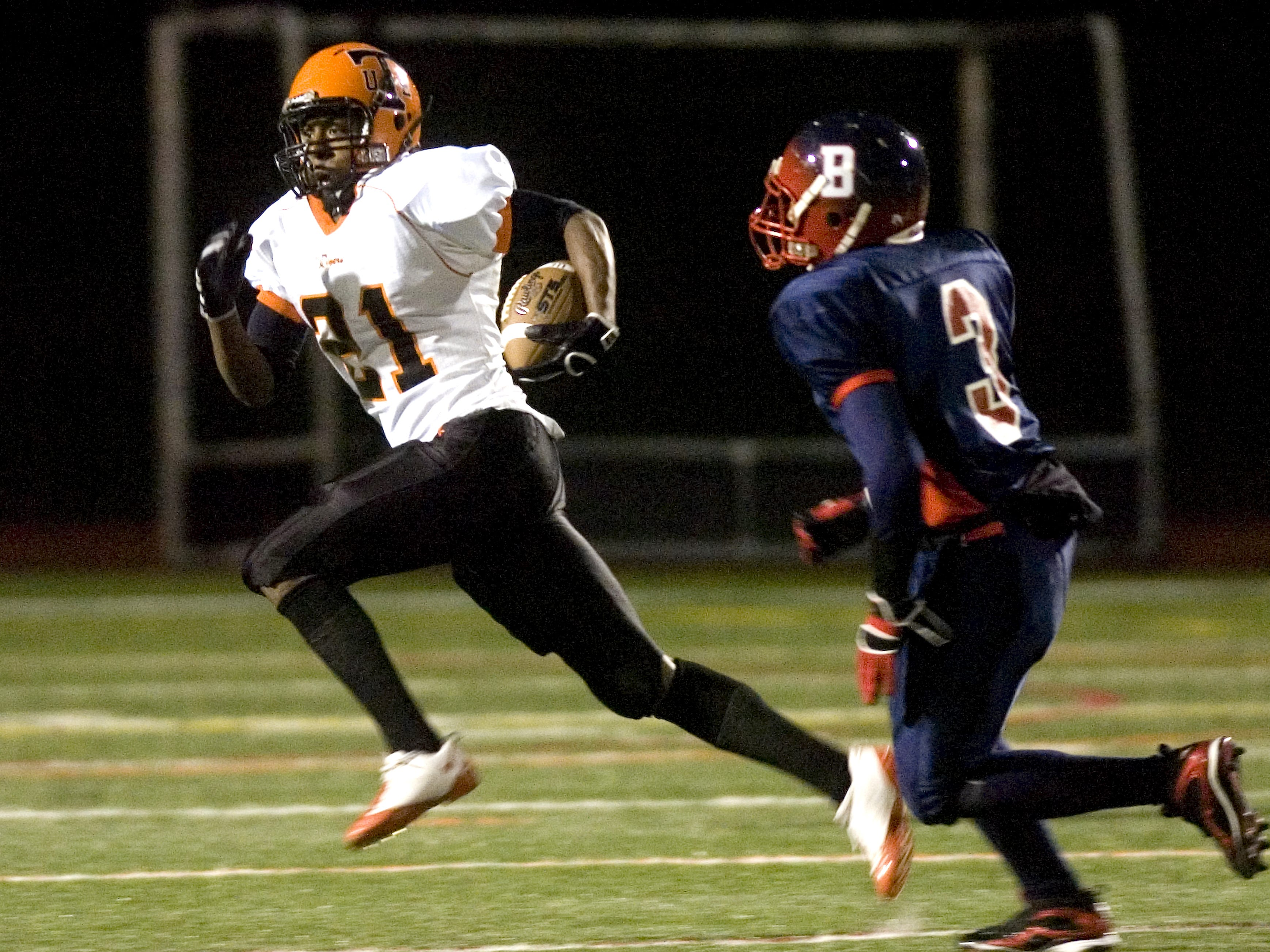 Union-Endicott's Jordan Thomas, left, goes to the outside as he tries to evade Binghamton's Delroy Young in the third quarter of a 2009 game at Dick Hoover Stadium in Vestal.