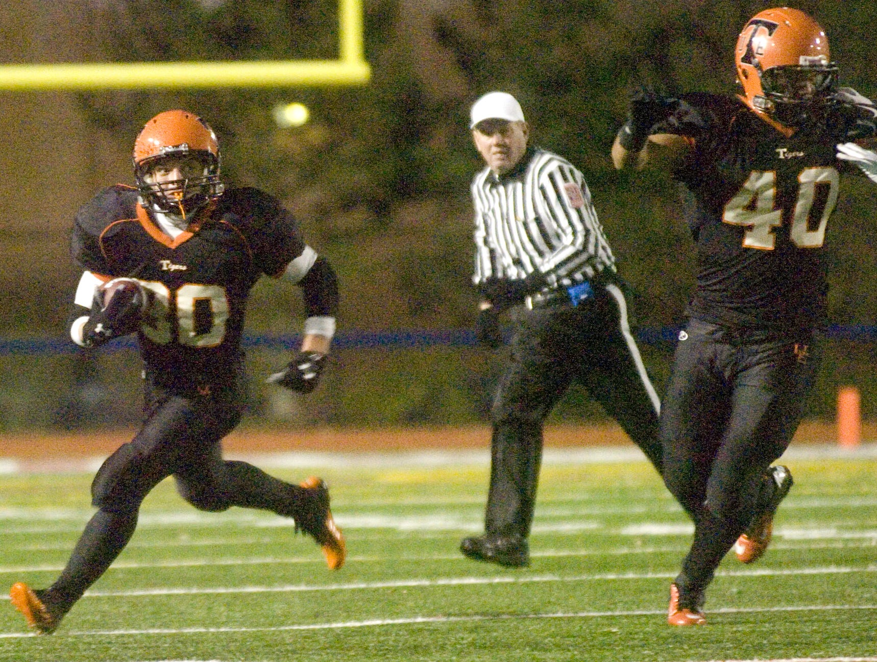 Michael Cheslock runs for a 9-yard gain in the second half of U-E?s 27-3 victory in the 2012 Section 4 Class A title game at Alumni Stadium.