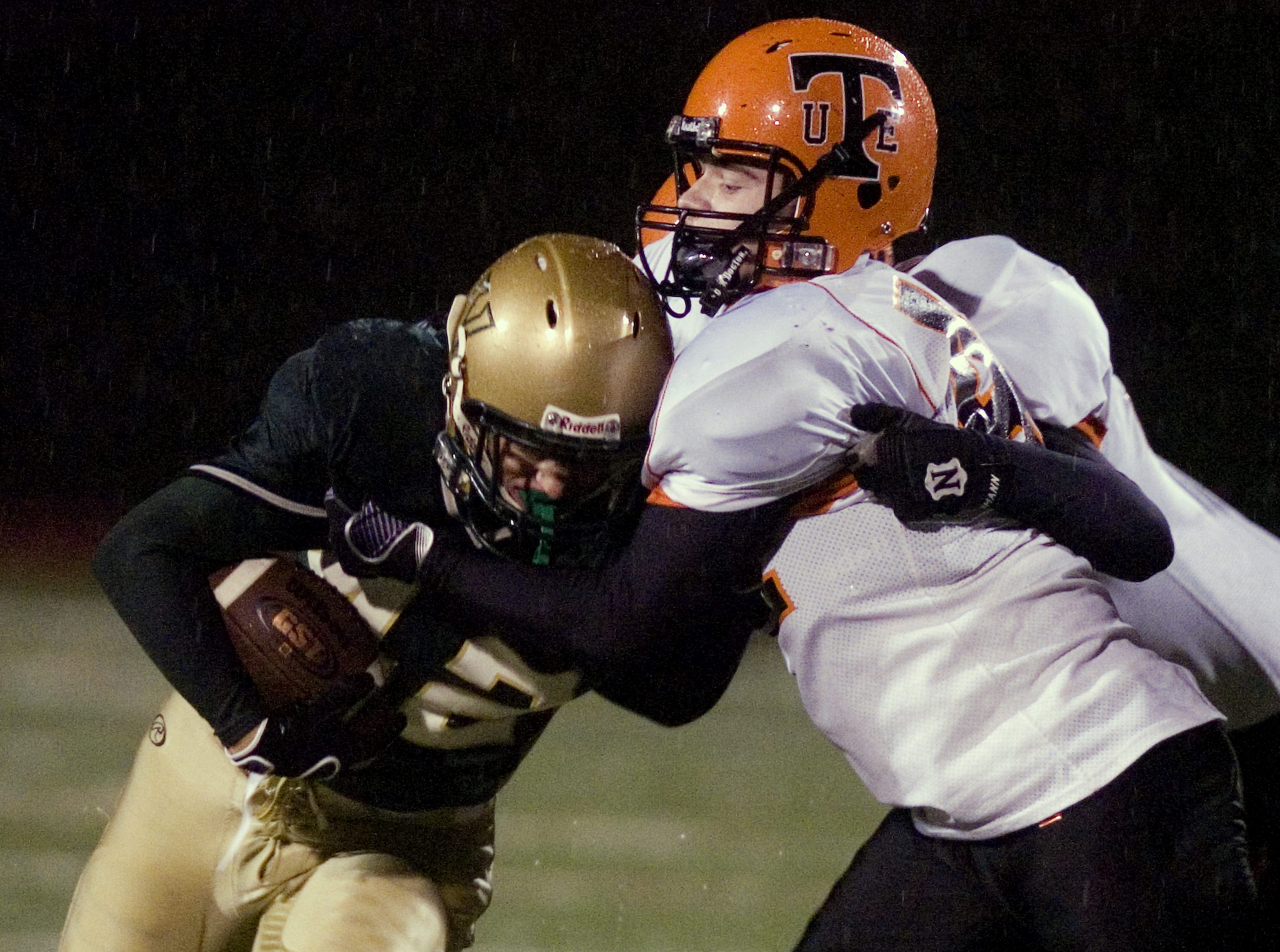 Union-Endicott's Troy Beddoe, front right, and Tyler Bayer tackle Vestal's Thad Zaparzynski, left, in the first quarter of a 2009 game at Dick Hoover Stadium.