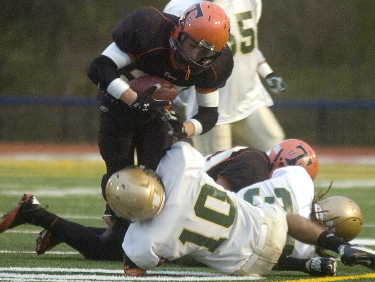 In 2012, Vestal's Mike Chewens trips up Union-Endicott's Michael Cheslock in the first half Friday night at Binghamton Alumni Stadium. Chewens kicked a 20-yard field goal in the first half Vestal's only points of the game.