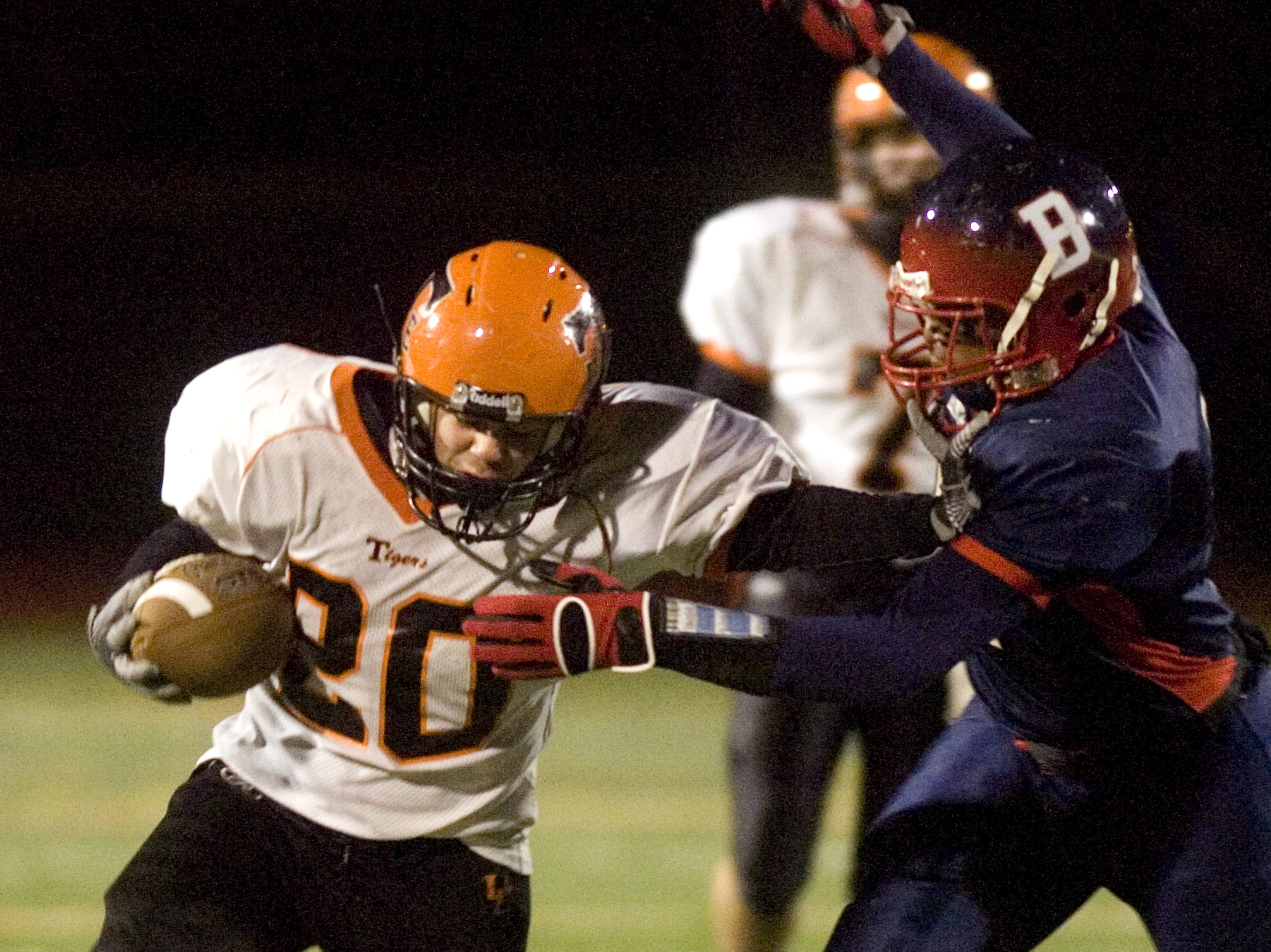 Union-Endicott's William Bedoya, left, stiff arms Binghamton's Delroy Young in the third quarter of a 2009 game at Dick Hoover Stadium in Vestal.