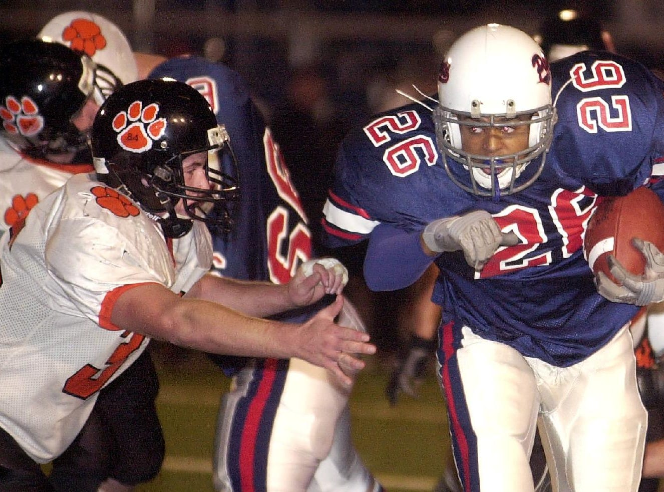 In 2001, Binghamton's Hakim Griffin, right, escapes the grasp of Union-Endicott's Jeremy Riley, left, to pick-up a first down with 3:08 left in the first half.