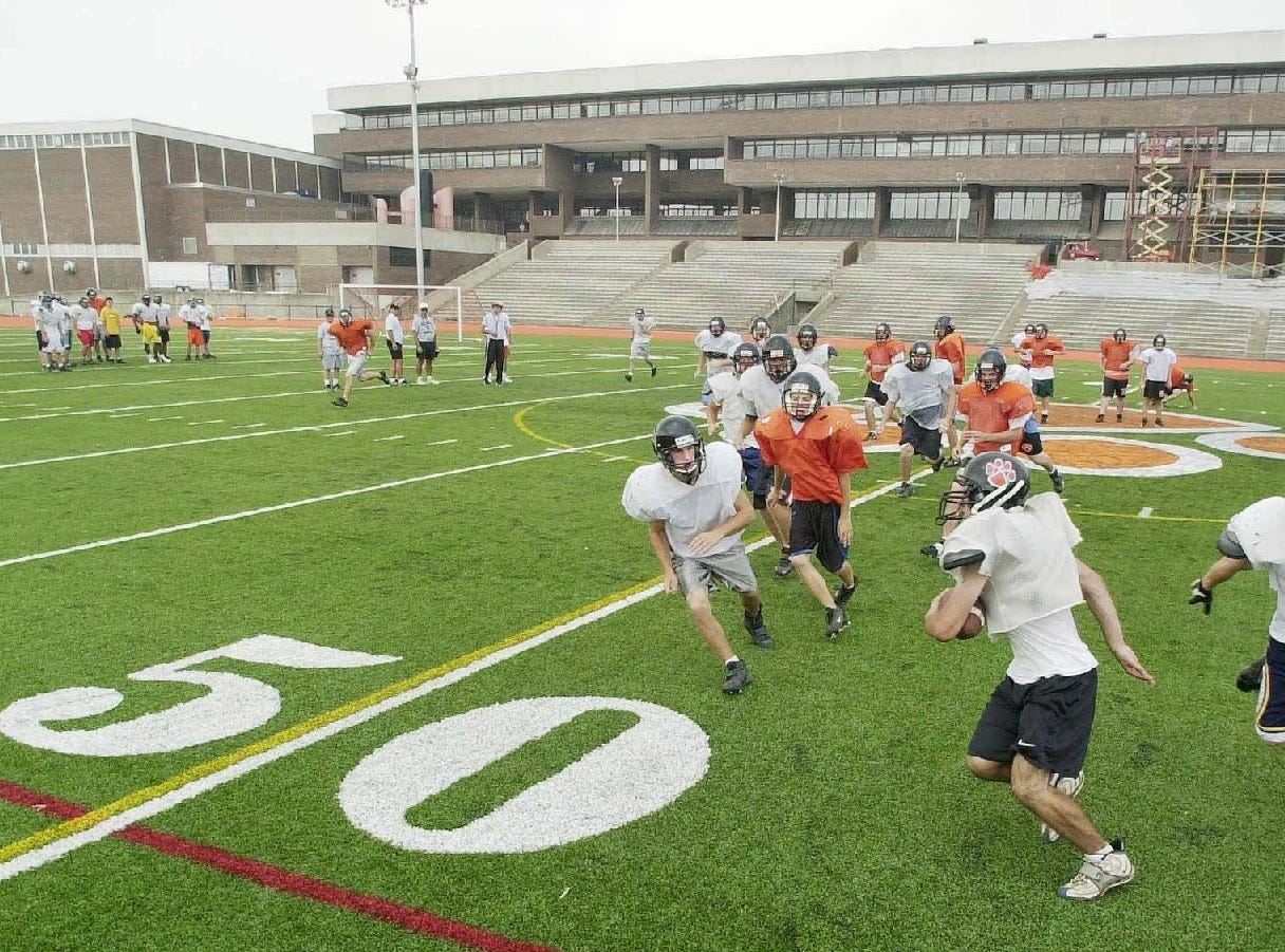 Members of the Union-Endicott football team practice on their new field in 2001.