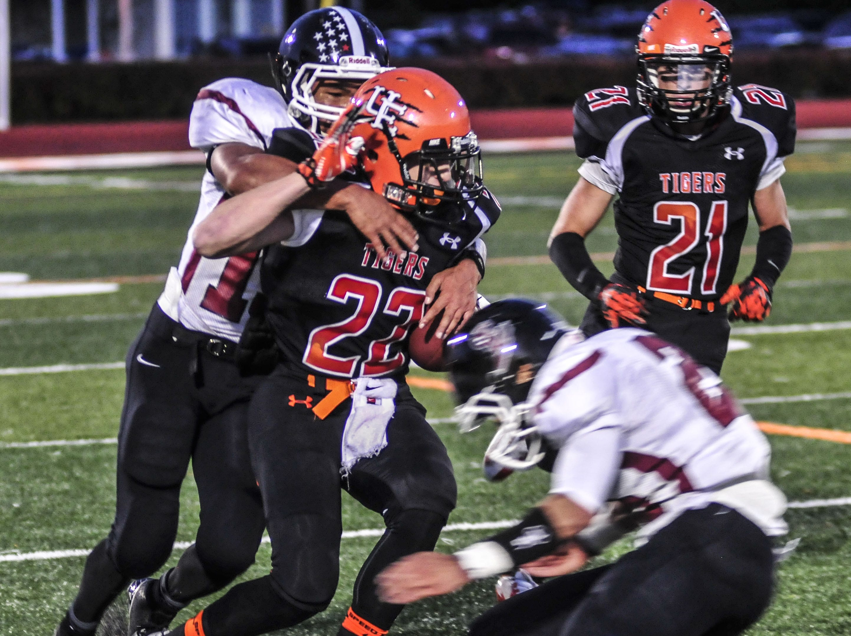 Union-Endicott's C.J. Krowiak is tackled by Elmira's Jerry McPeak, left, and Levi Stevenson in 2013. Krowiak had 140 yards receiving and two TDs.