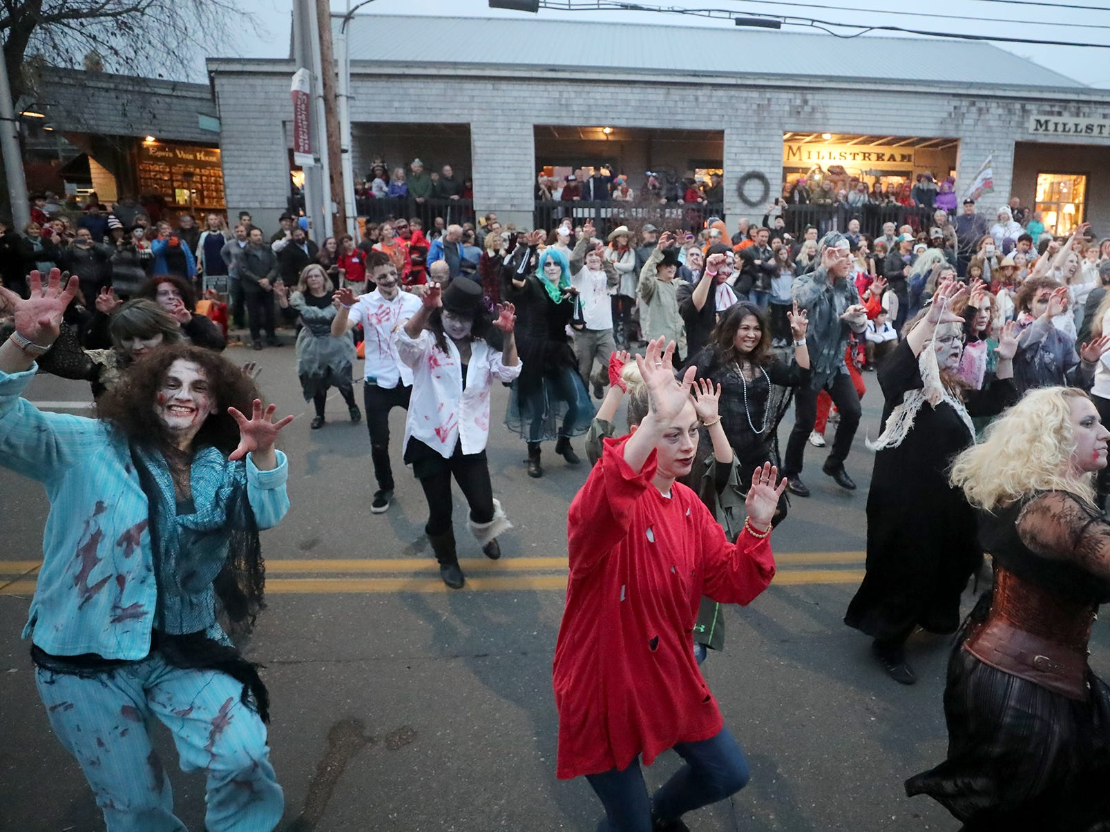 "Zombies dance to the Michael Jackson classic ""ÊThriller"" during the Bainbridge Island Halloween Walk along Winslow Way on October, 31, 2018."