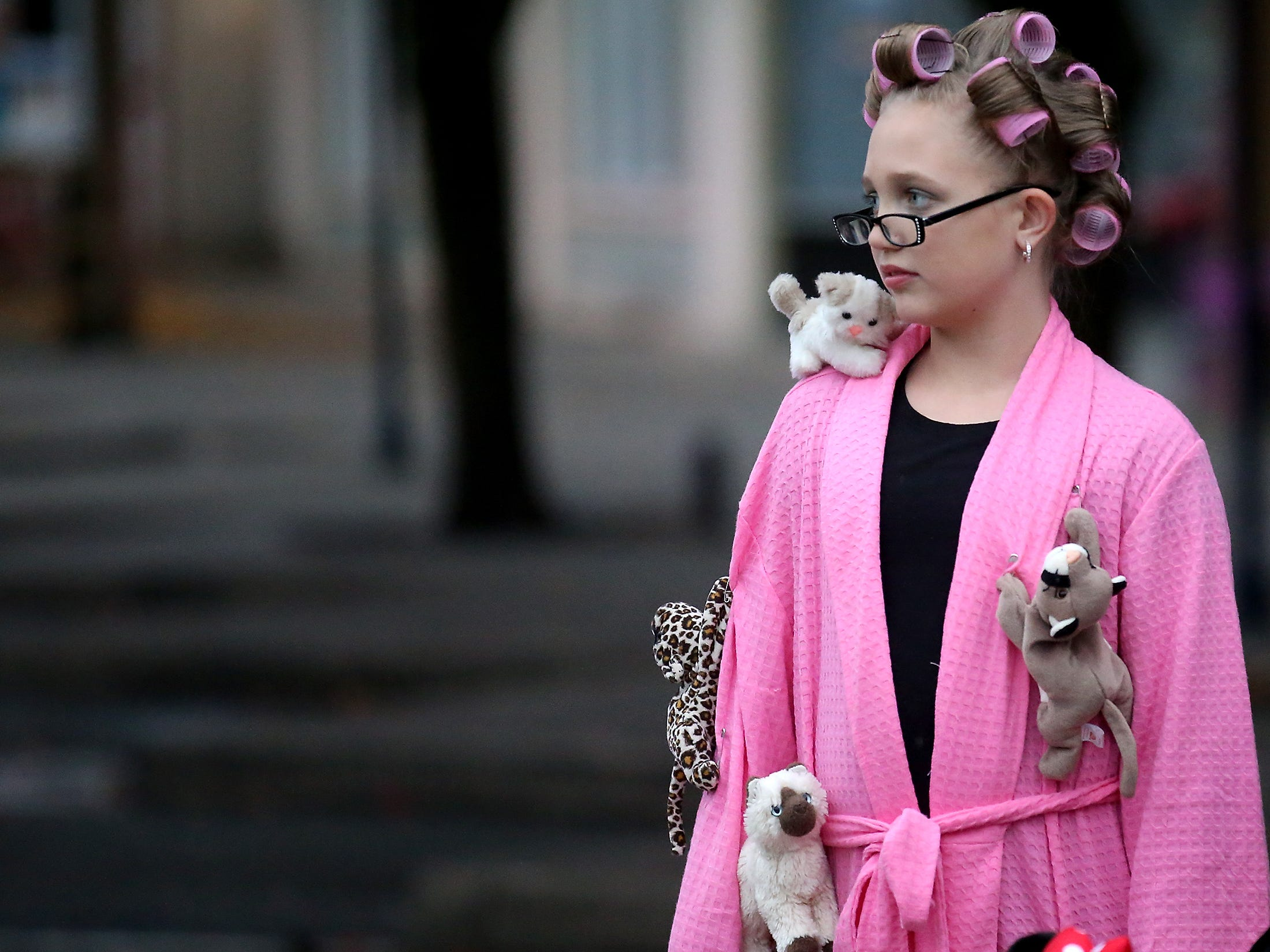 Dressed as a crazy cat lady Jaylen Jacobsen, 12, waits to cross the street while trick-or-treating with her family at Downtown Bremerton's Trick or Treat Street on Wednesday, October 31, 2018.
