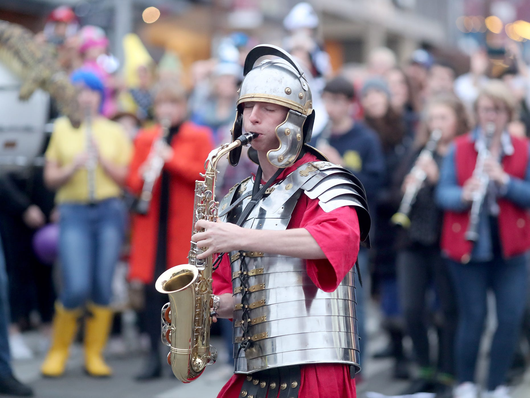 Bainbridge band member Sean Halstead dressed as a Roman to play the sax at the Bainbridge Island Halloween Walk on October, 31, 2018.