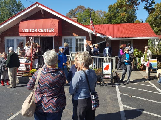 Over 300 Swannanoa Valley residents showed up to the Black Mountain-Swannanoa Chamber of Commerce on Oct. 28 to celebrate the 100th anniversary of the building that is now home to its visitor center.