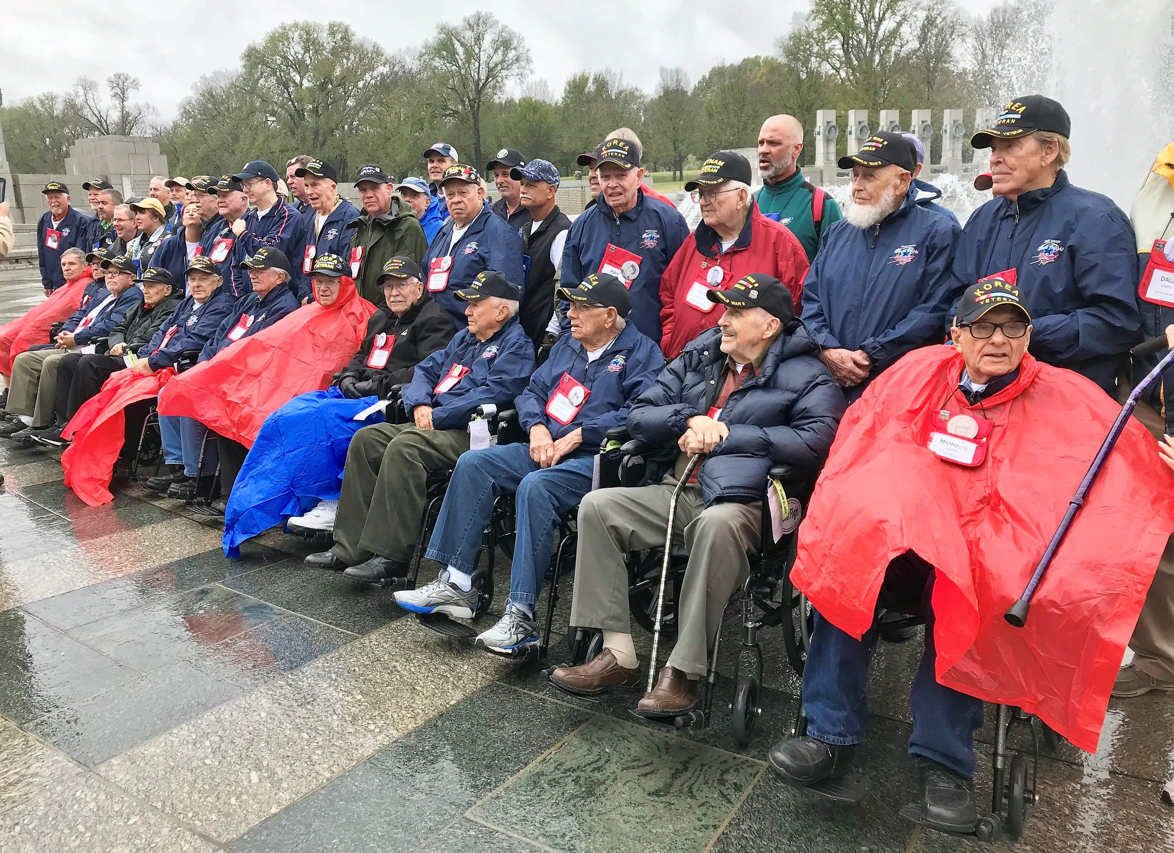 Space Coast Honor Flight attendees pose for photos Oct. 27 at the World War II Memorial in Washington, D.C.